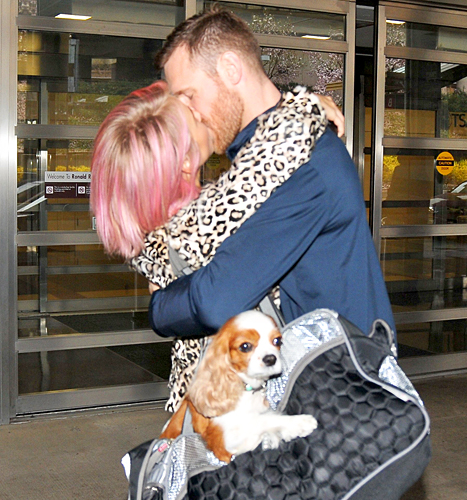 Julianne Hough and Brooks Laich kiss at airport