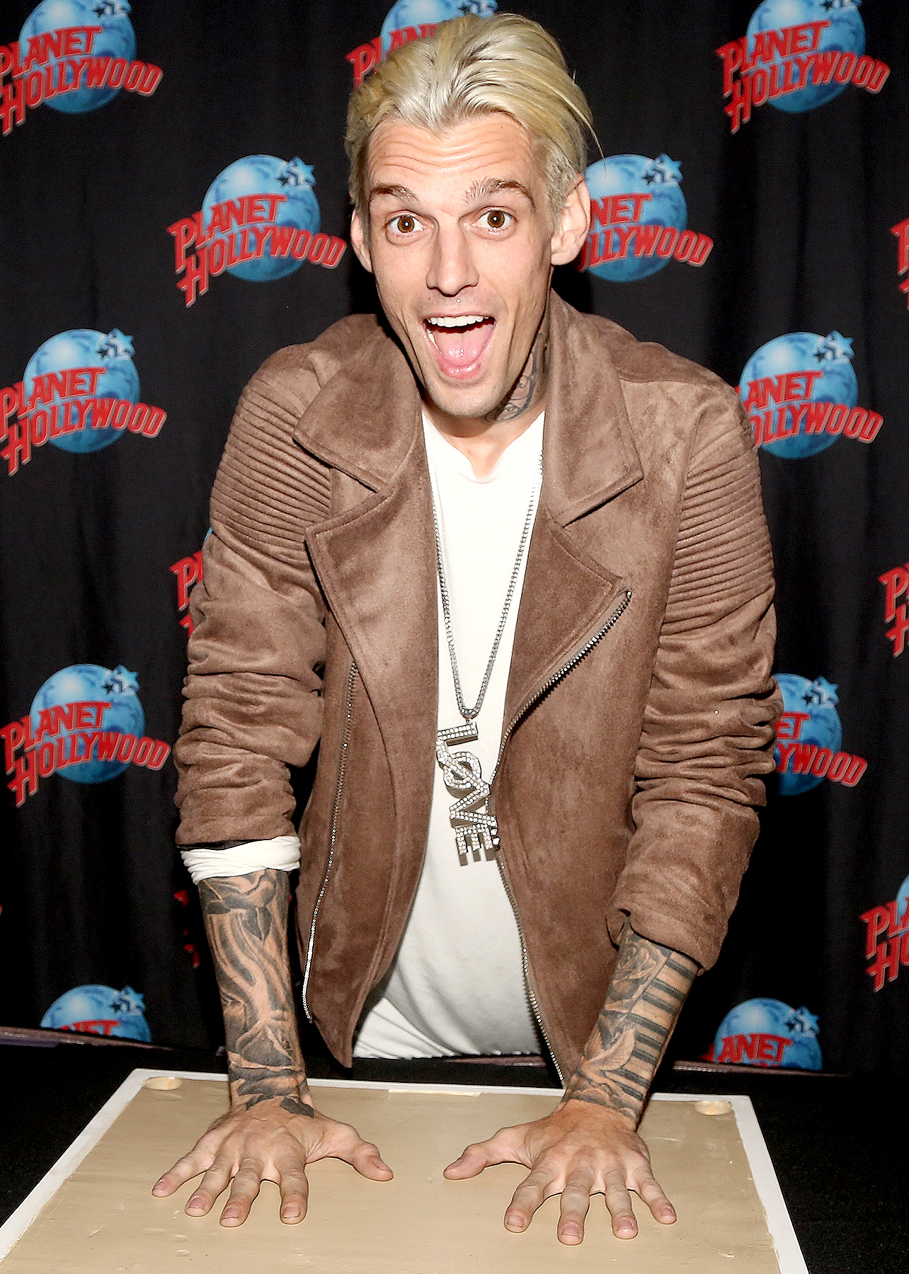 Aaron Carter poses during a handprint ceremony and meet & greet with fans as he visits Planet Hollywood Times Square on April 24, 2017 in New York City.