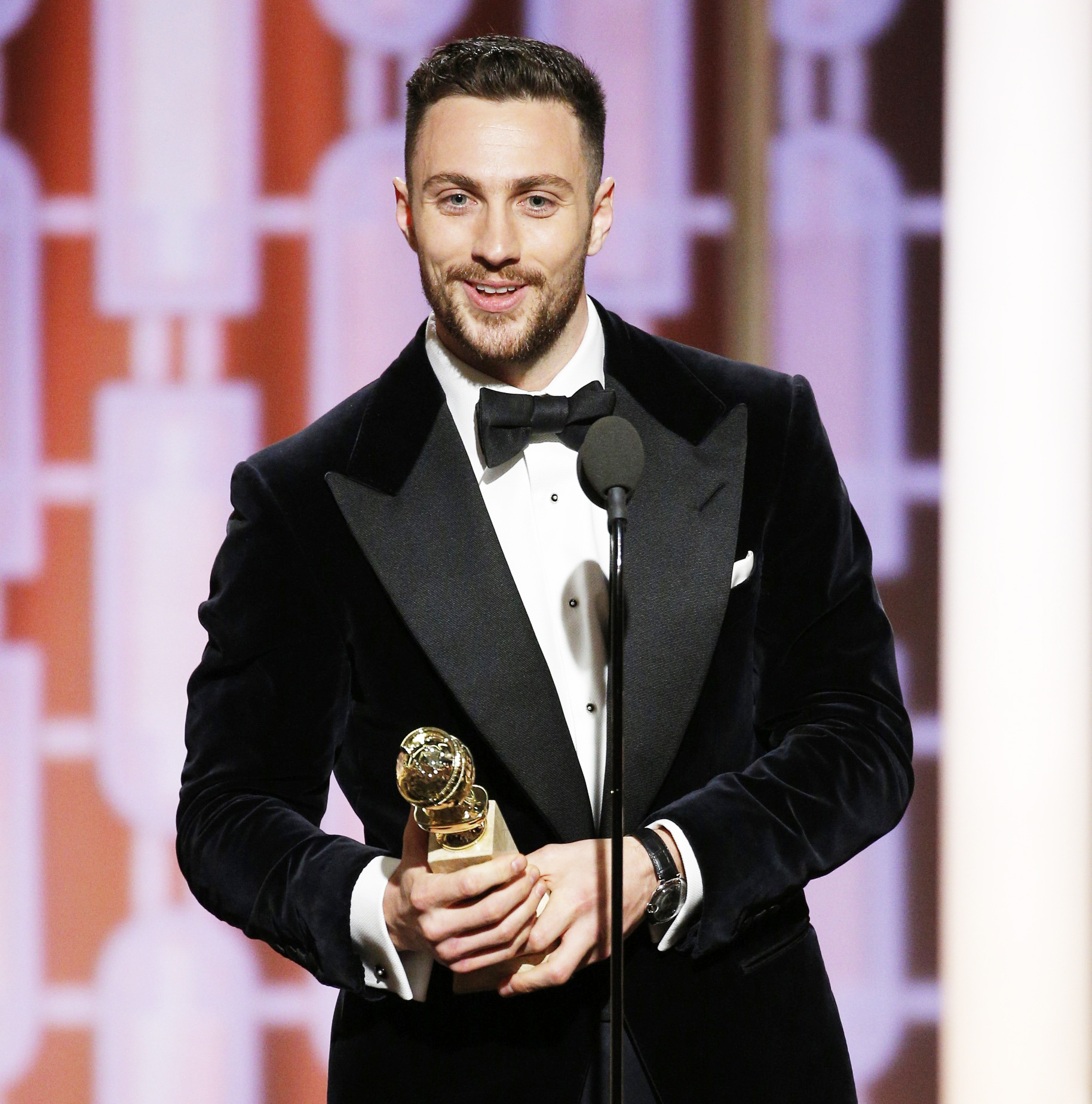 Aaron Taylor-Johnson accepts the award for Best Supporting Actor In A Motion Picture for his role in