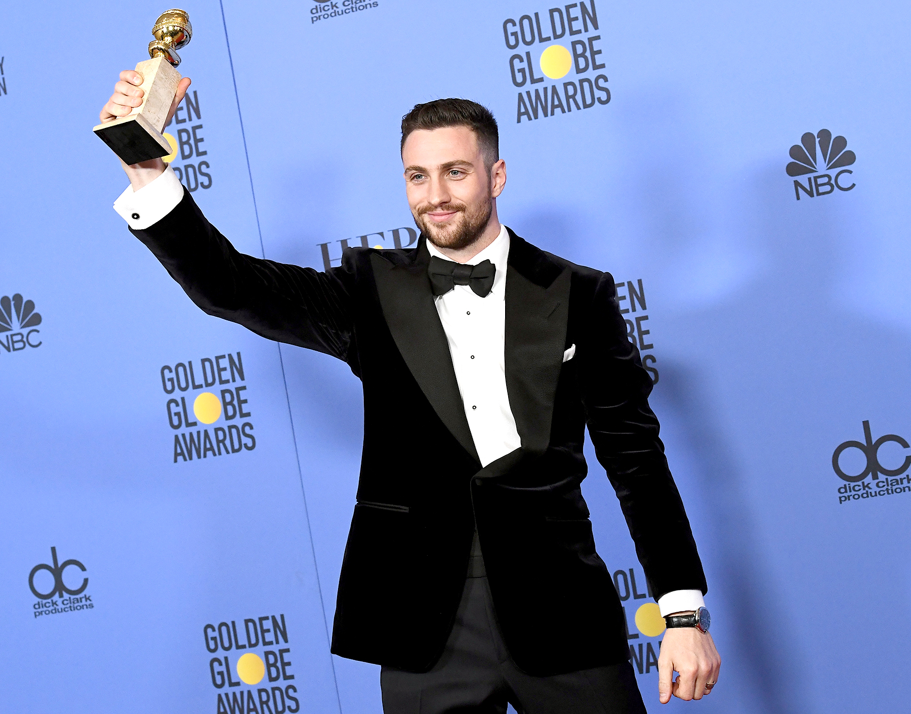 Aaron Taylor-Johnson, winner of Best Performance by an Actor in a Supporting Role for 'Nocturnal Animals', poses in the press room at the 74th Annual Golden Globe Awards.