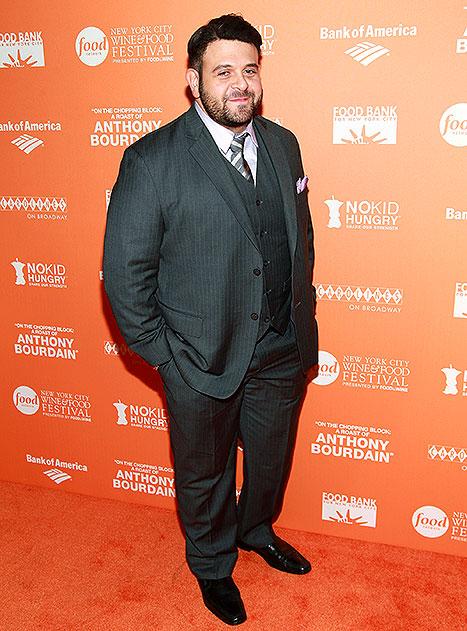 Man v. Food star Adam Richman shows off 70 lb. weight