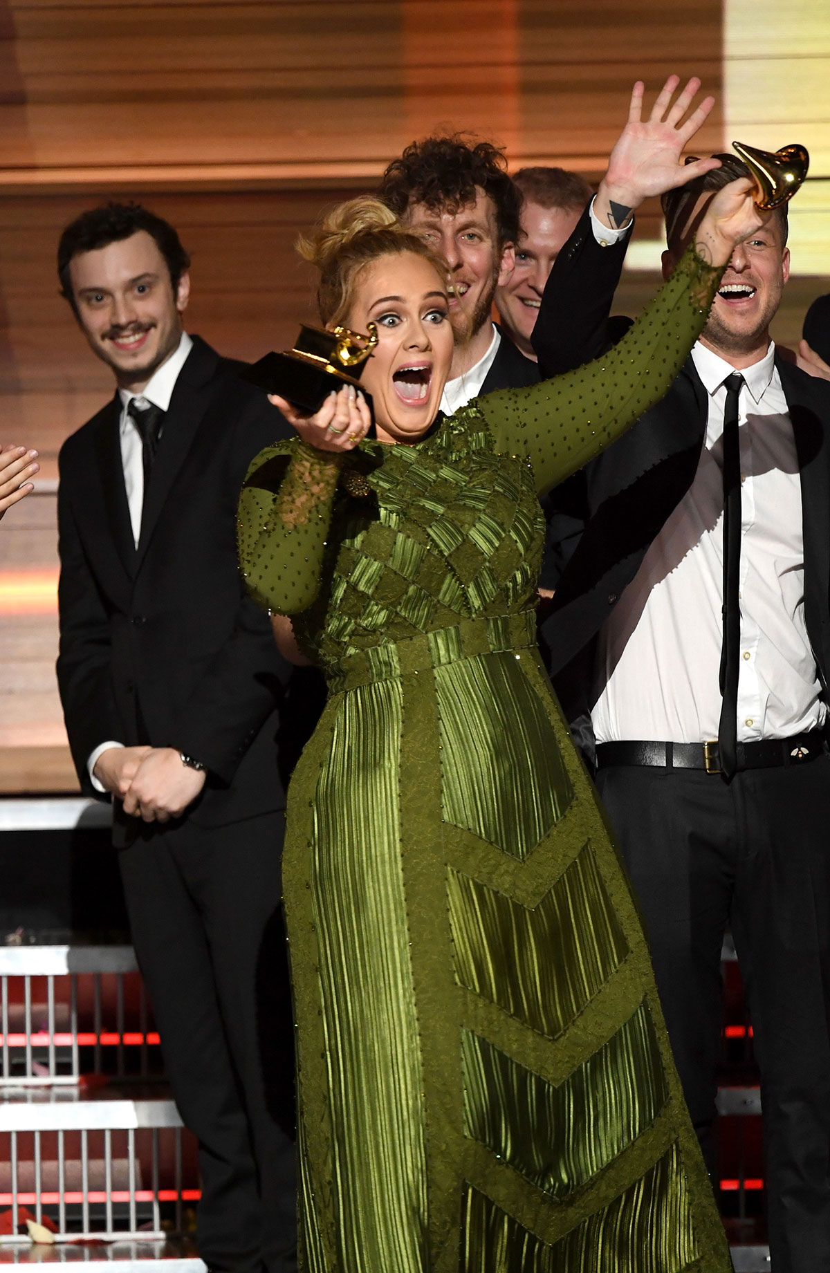 Adele breaks her Grammy in half at the 2017 awards show.