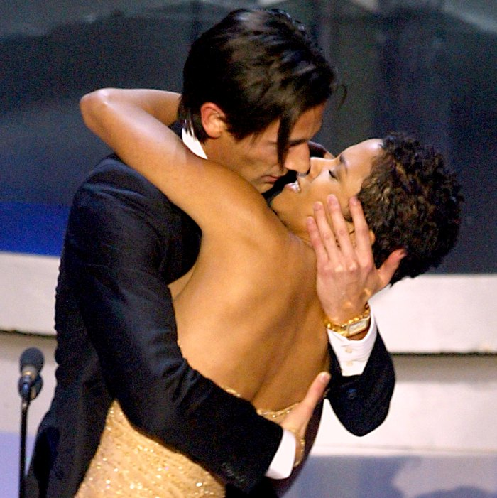 Adrien Brody surprises presenter Halle Berry with a kiss after he won the Oscar for best actor for his work in 'The Pianist'