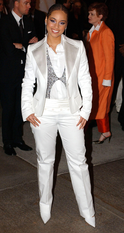 Alicia Keys - In a satin pantsuit.