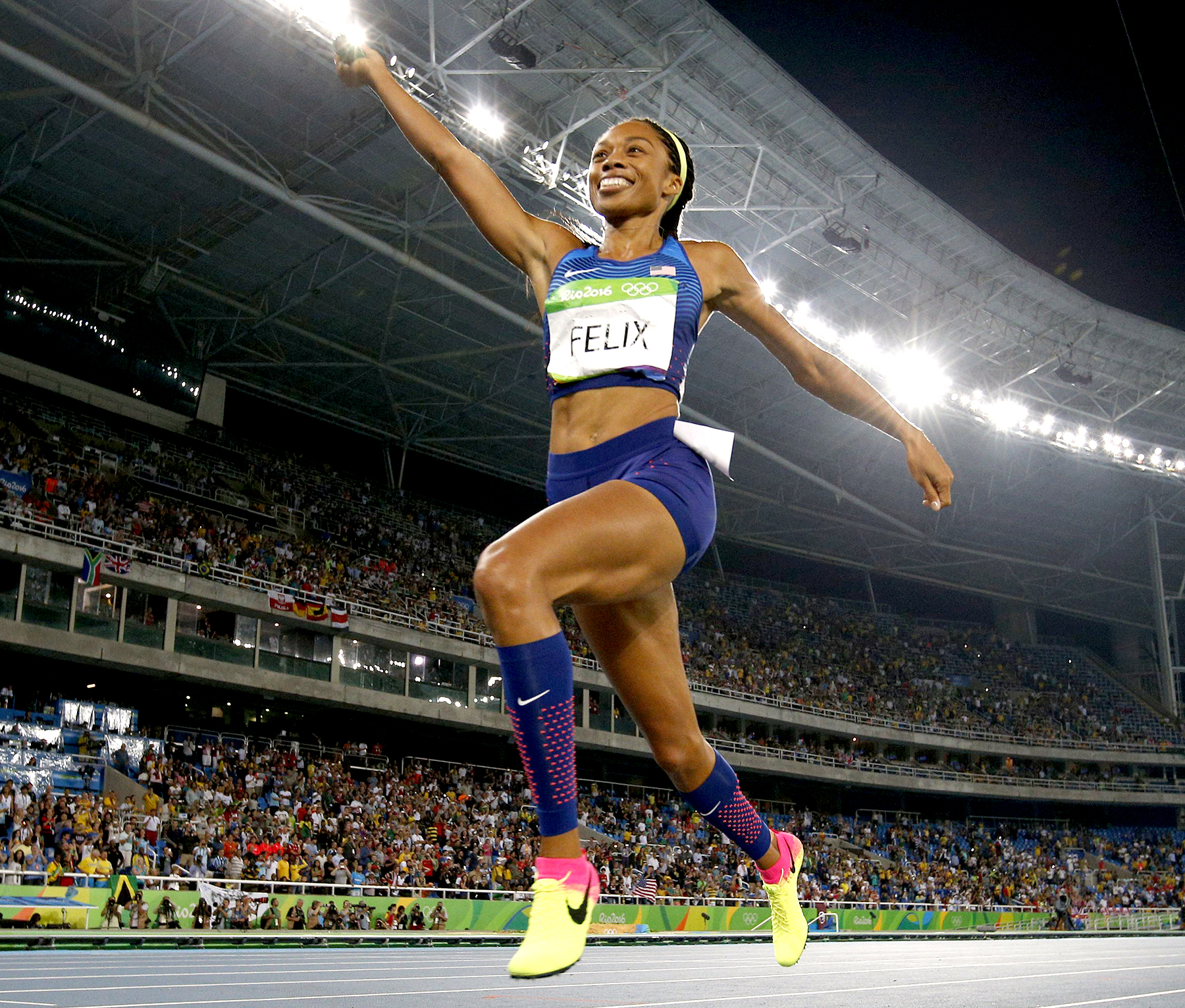 USA's Allyson Felix celebrates winning the Women's 4x400m Relay Final during the athletics event at the Rio 2016 Olympic Games at the Olympic Stadium in Rio de Janeiro on August 20, 2016.