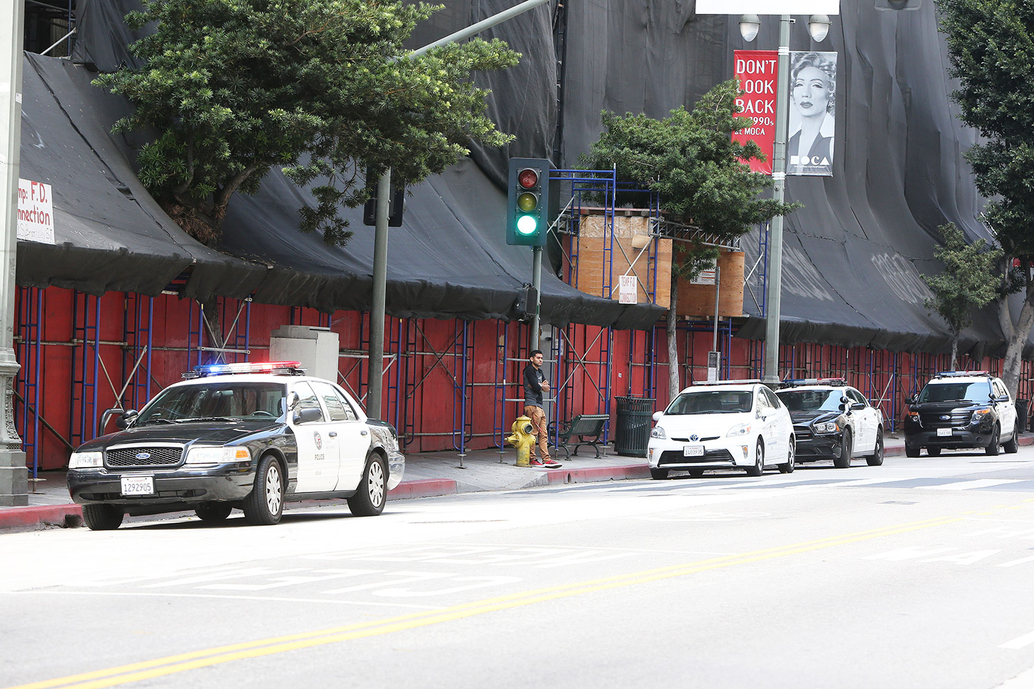 Police outside Amber Heard's downtown Los Angeles apartment amid claims Johnny Depp's people are removing items.
