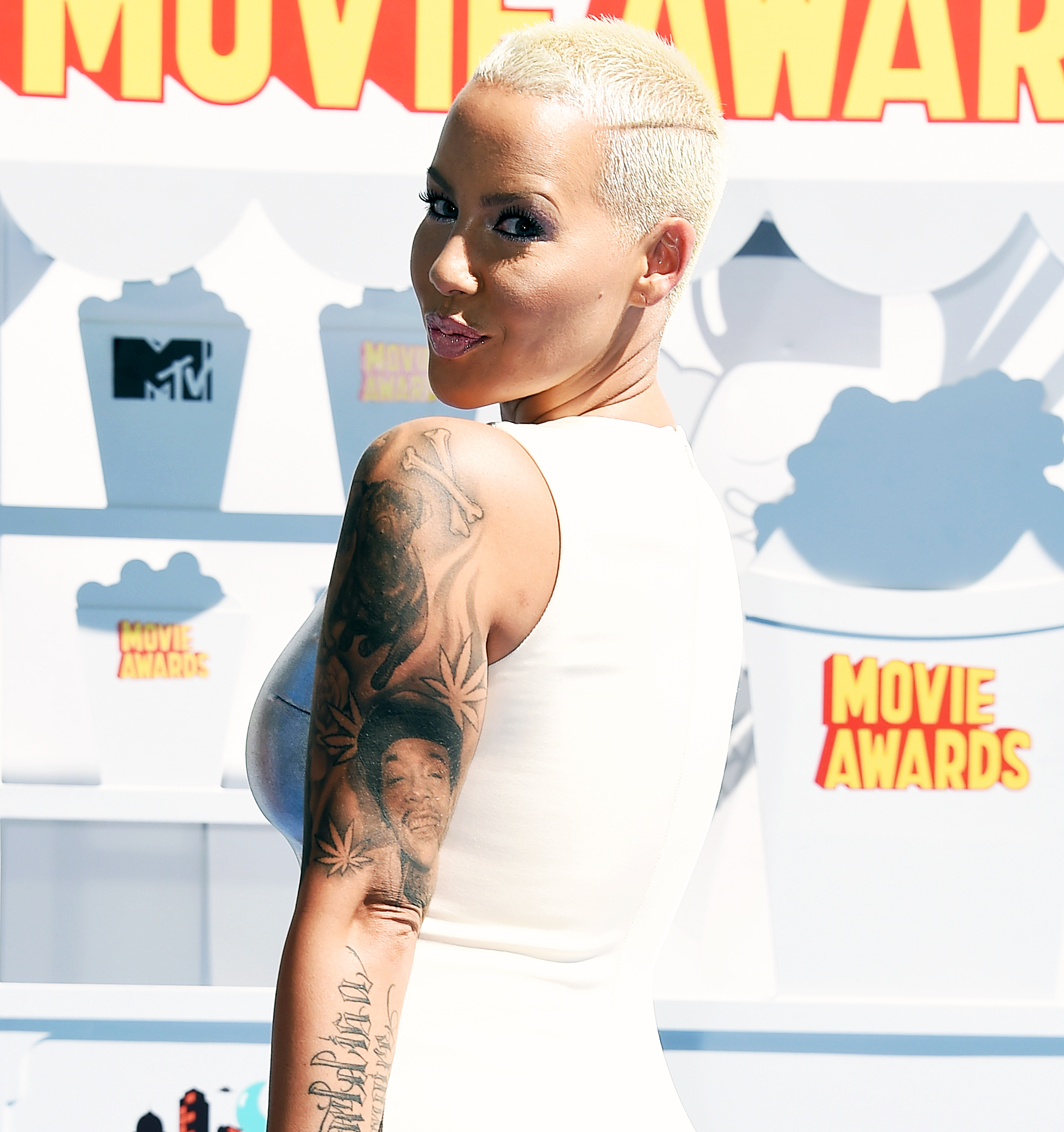 41865f82985e2 Amber Rose Covers Tattoo of Ex Wiz Khalifa With Another Man