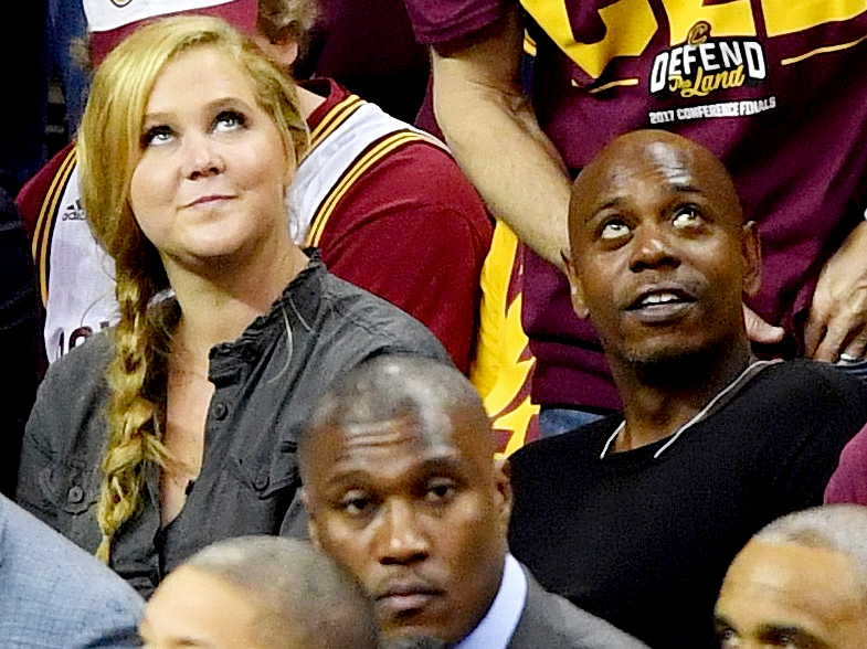 Amy Schumer and Dave Chappelle attend Game Three of the 2017 NBA Eastern Conference Finals between the Cleveland Cavaliers and the Boston Celtics at Quicken Loans Arena on May 21, 2017 in Cleveland, Ohio.