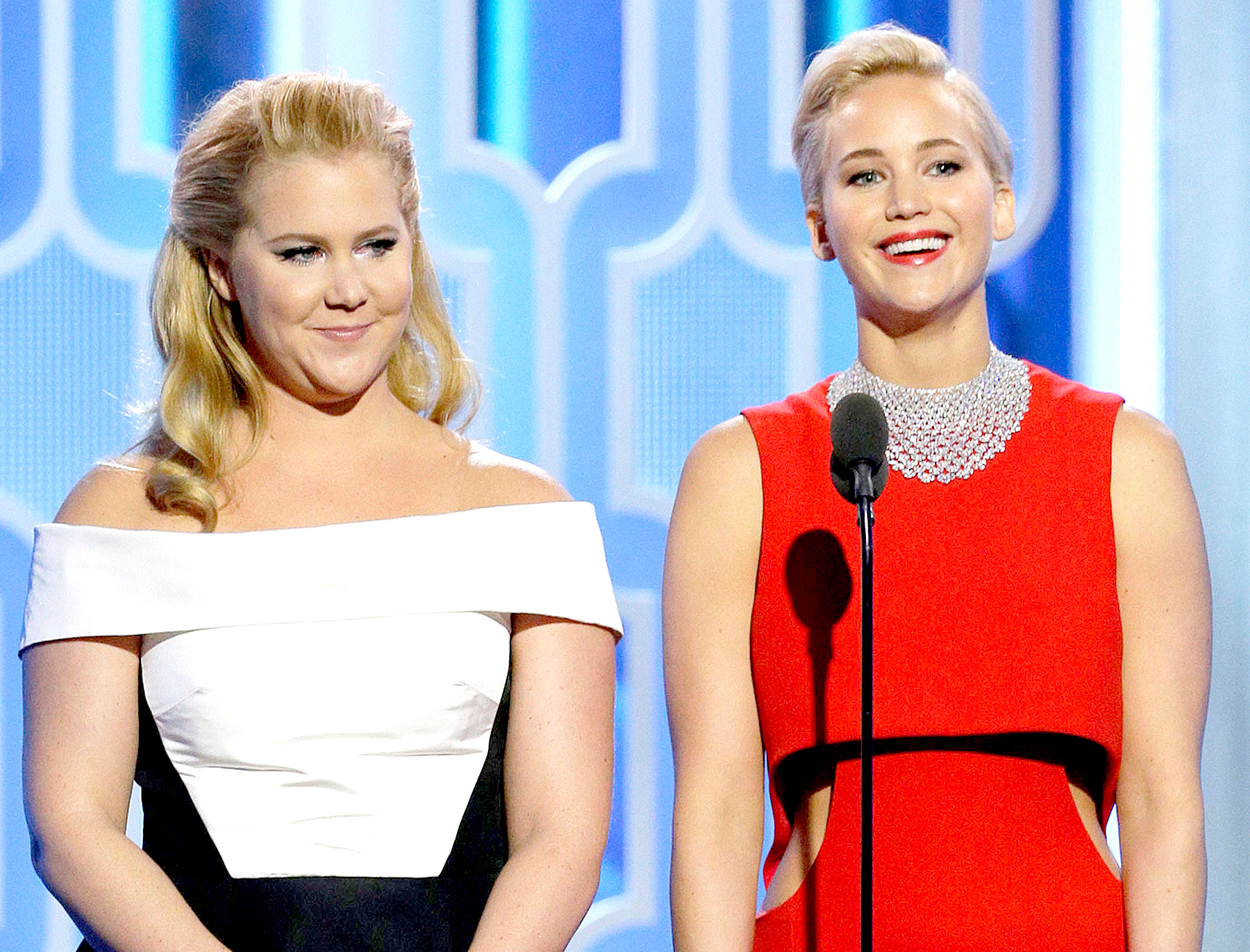 Amy Schumer and Jennifer Lawrence speak onstage during the 73rd Annual Golden Globe Awards at The Beverly Hilton Hotel on January 10, 2016 in Beverly Hills, California.