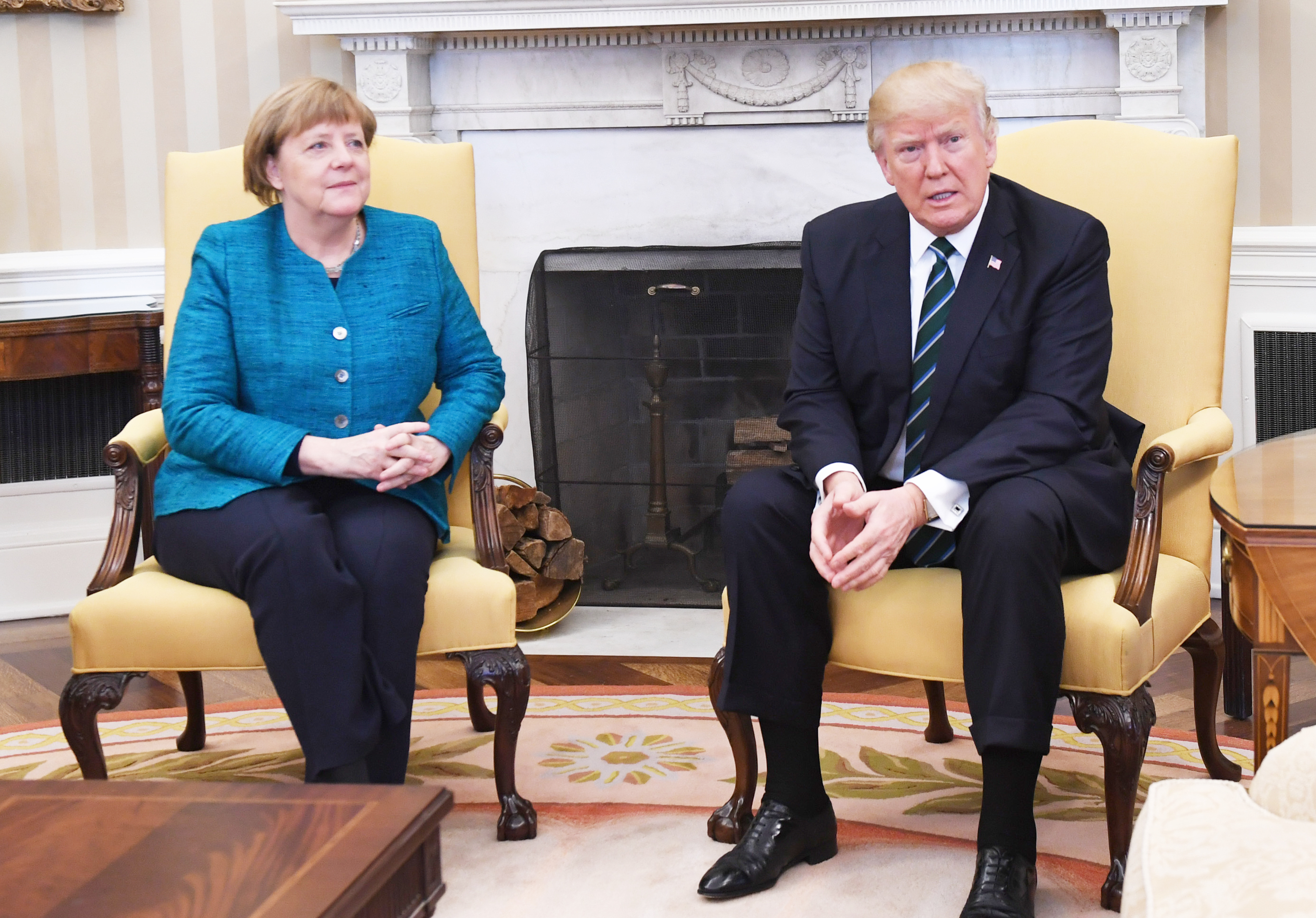 U.S. President Donald Trump, speaks while Angela Merkel, Germany's chancellor, left, listens during a meeting in the Oval Office of the White House in Washington, D.C., U.S., on Friday, March 17, 2017.