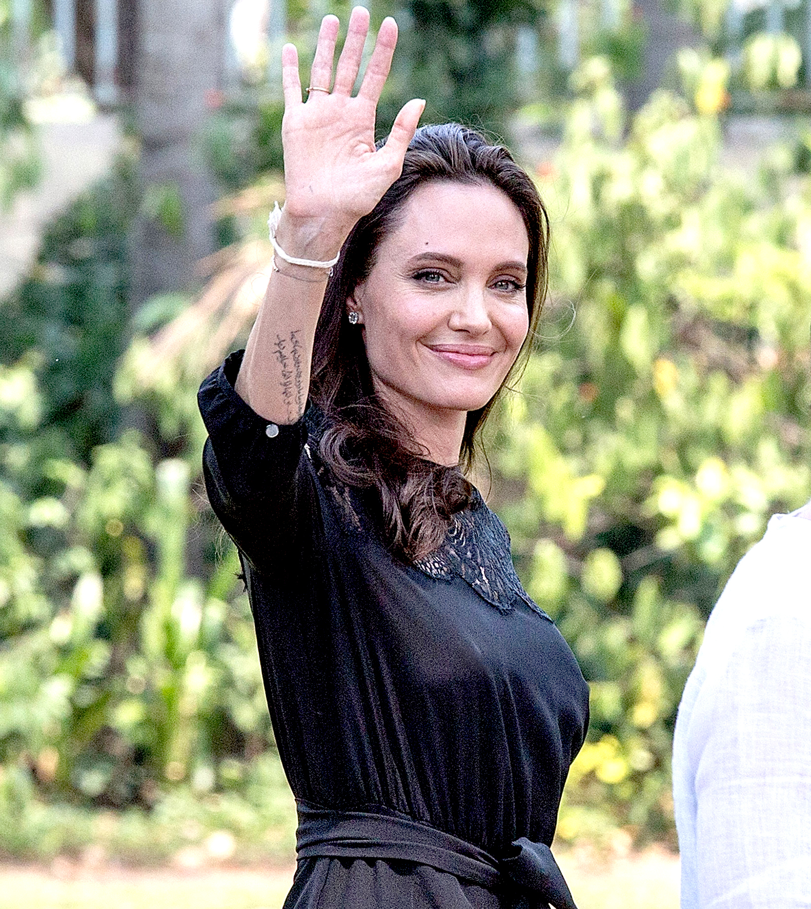 """Angelina Jolie greets members of the press while leaving a press conference ahead of the premiere of her new film """"First They Killed My Father"""" set up at the Raffles Grand Hotel D'Angkor on February 18, 2017 in Siem Reap, Cambodia."""