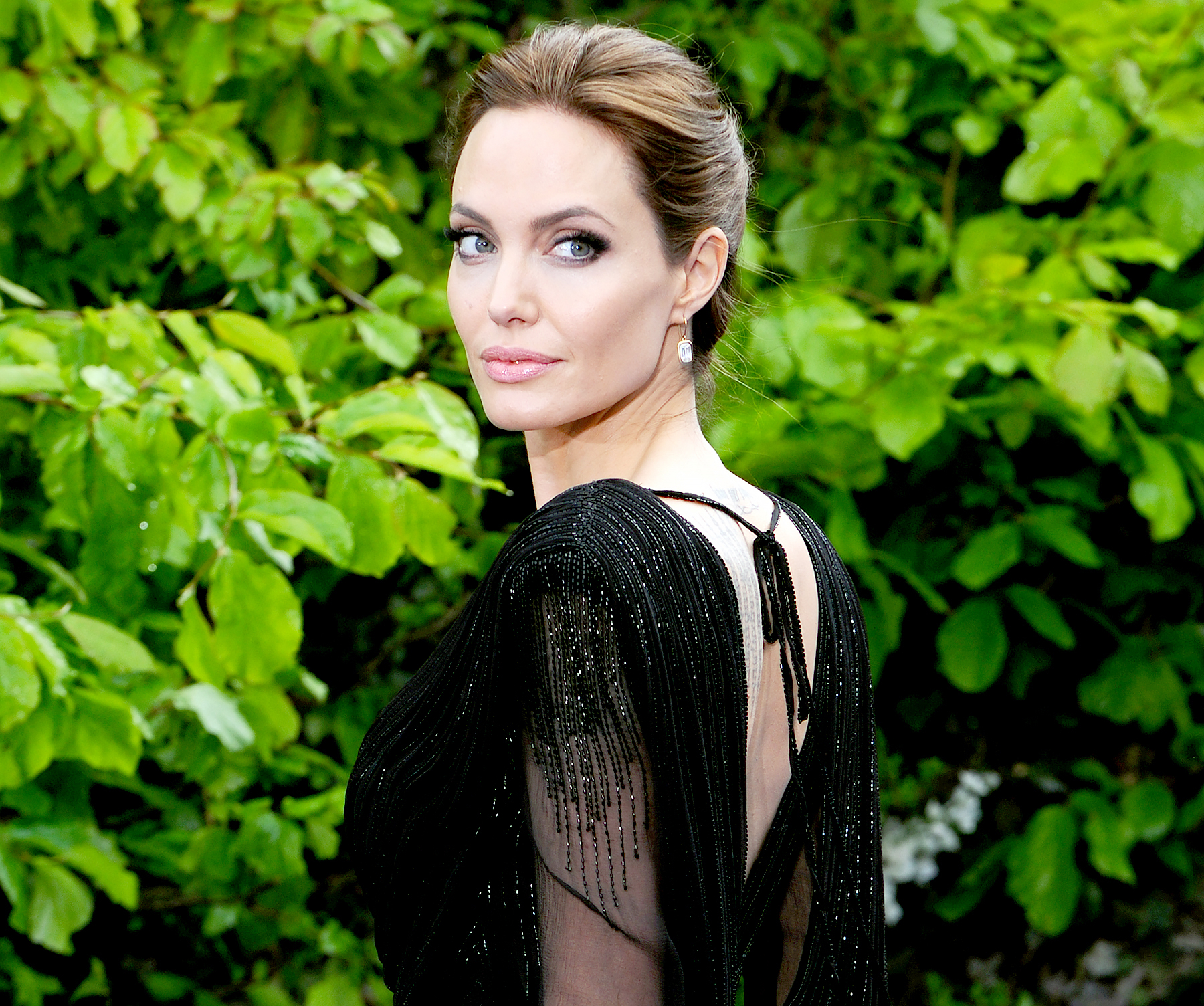 Angelina Jolie attends a private reception as costumes and props from Disney's 'Maleficent' are exhibited in support of Great Ormond Street Hospital at Kensington Palace in London on May 8, 2014.