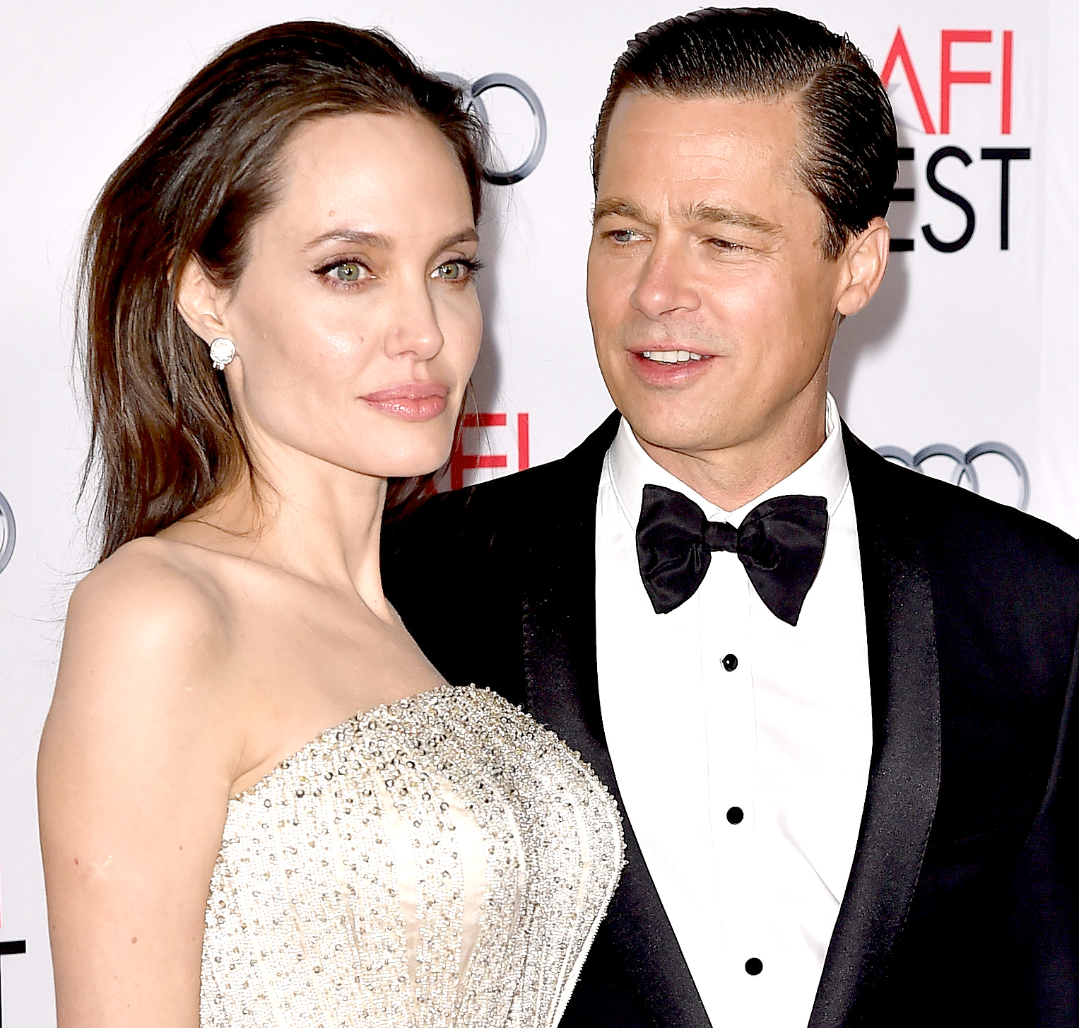 Angelina Jolie and Brad Pitt arrive at the AFI FEST 2015 presented by Audi opening night gala premiere of Universal Pictures'