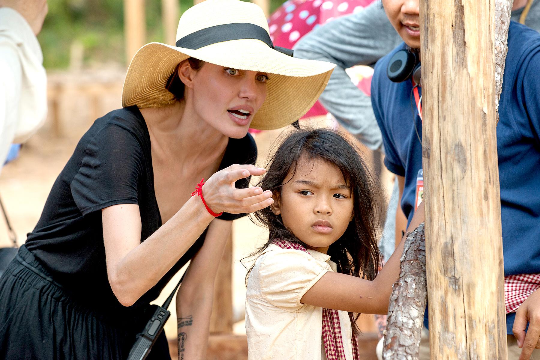 Angelina Jolie and Sareum Srey Moch