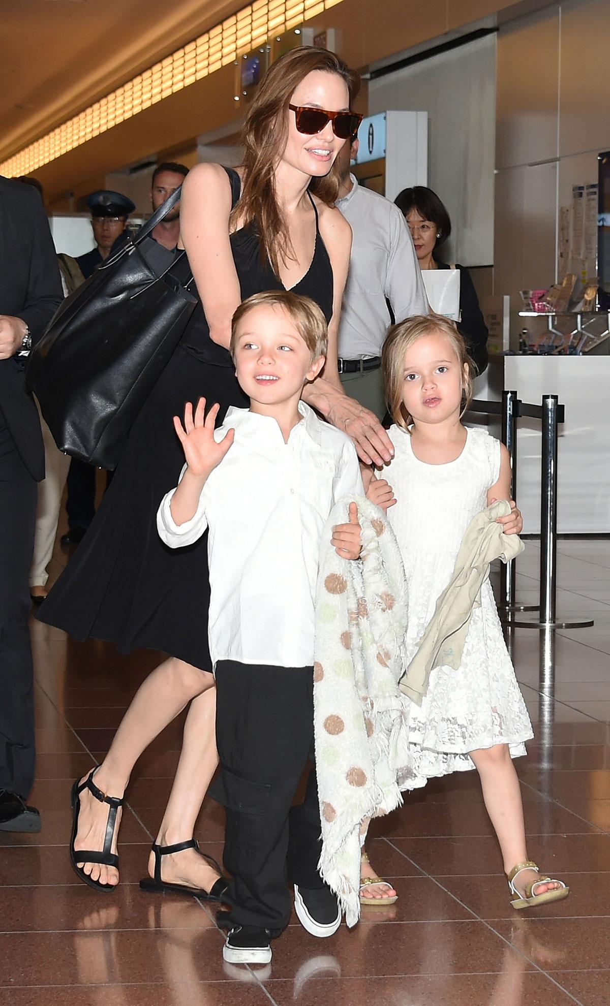 Knox Jolie-Pitt, Angelina Jolie and Vivienne Jolie-Pitt are seen upon arrival at Haneda Airport on June 21, 2014 in Tokyo, Japan