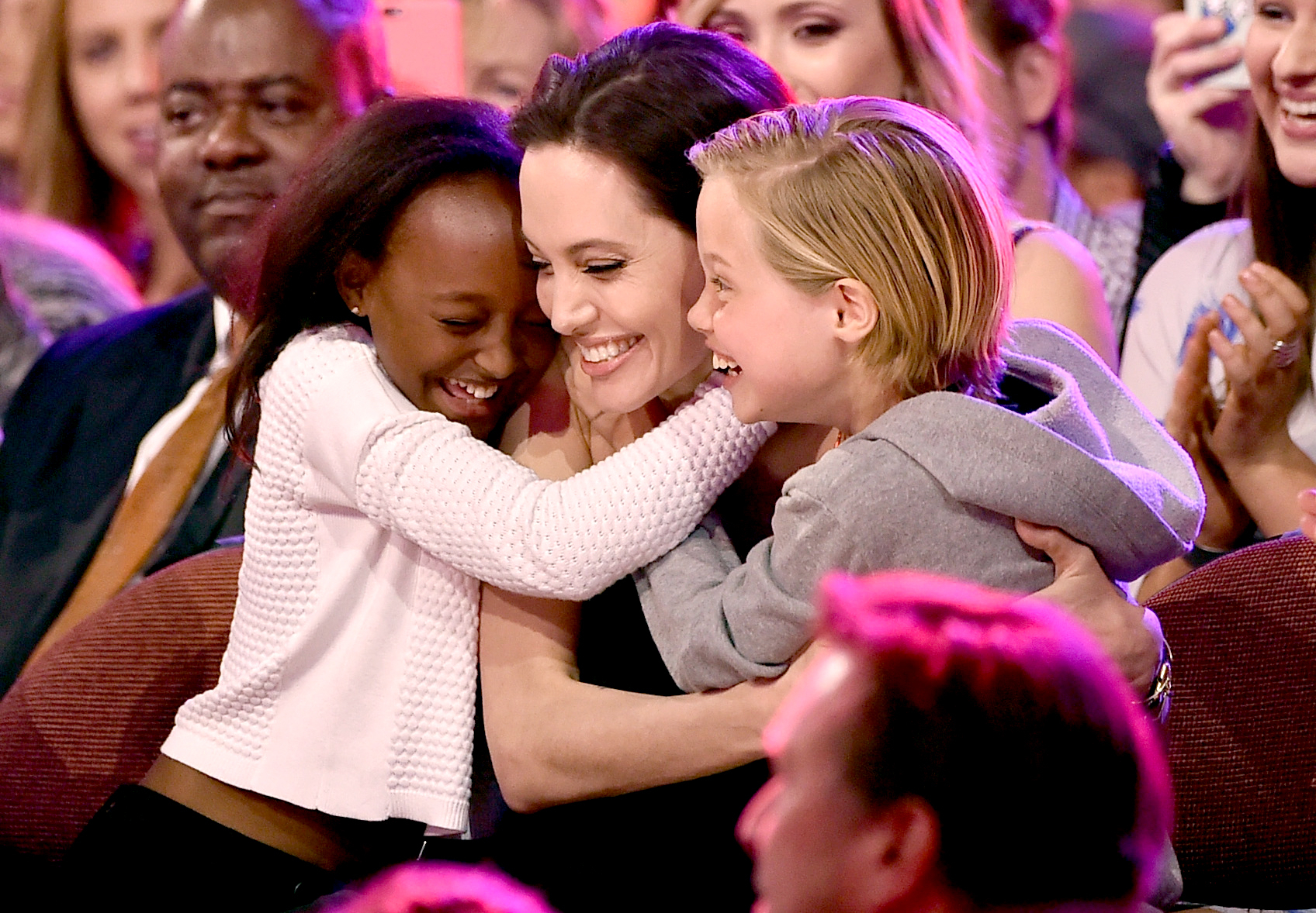 Angelina Jolie hugs Zahara Marley Jolie-Pitt (L) and Shiloh Nouvel Jolie-Pitt (R) after winning award for Favorite Villain in 'Maleficent' during Nickelodeon's 28th Annual Kids' Choice Awards held at The Forum on March 28, 2015 in Inglewood, California.
