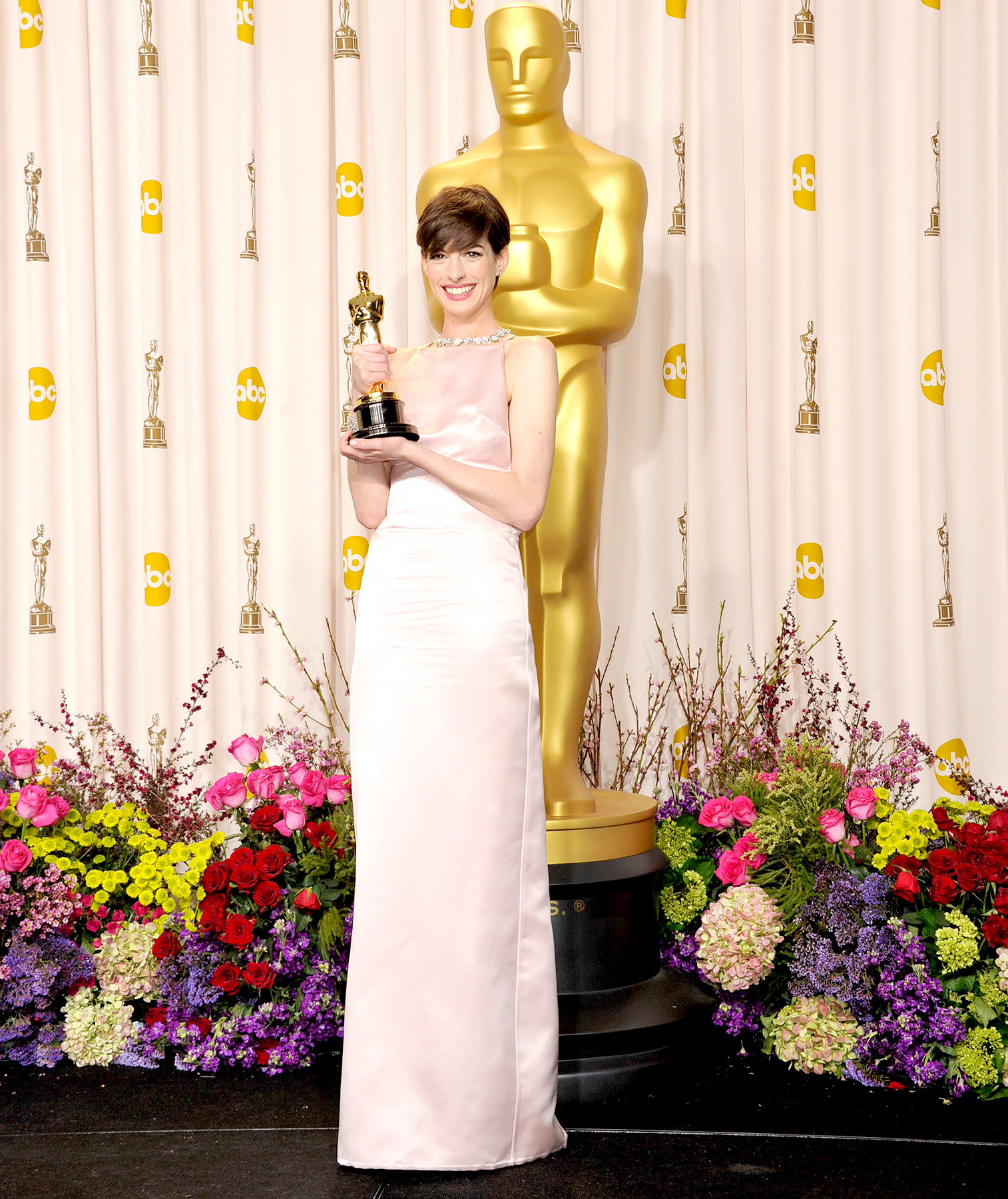Anne Hathaway arrives to the 85th Annual Academy Awards.