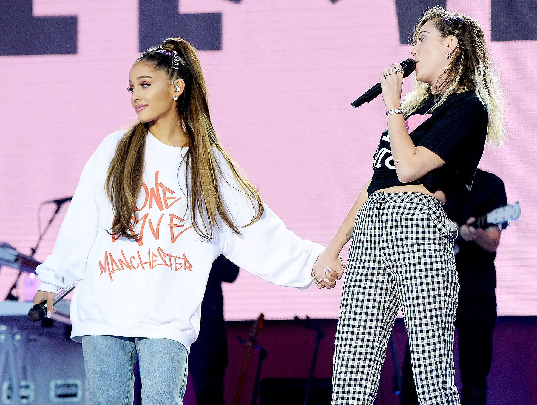 Ariana Grande and Miley Cyrus perform on stage during the One Love Manchester Benefit Concert at Old Trafford Cricket Ground on June 4, 2017 in Manchester, England.