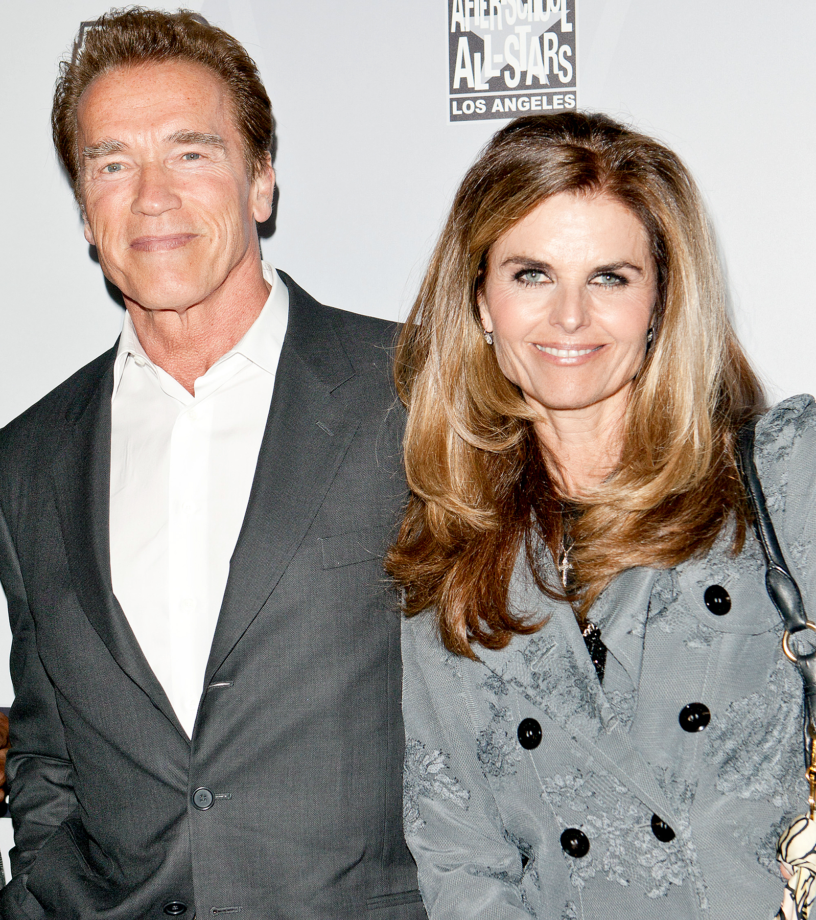 Arnold Schwarzenegger (L) and Maria Shriver (R) arrive at After-School All-Stars Hoop Heroes Salute launch party at Katsuya on February 18, 2011 in Los Angeles, California.