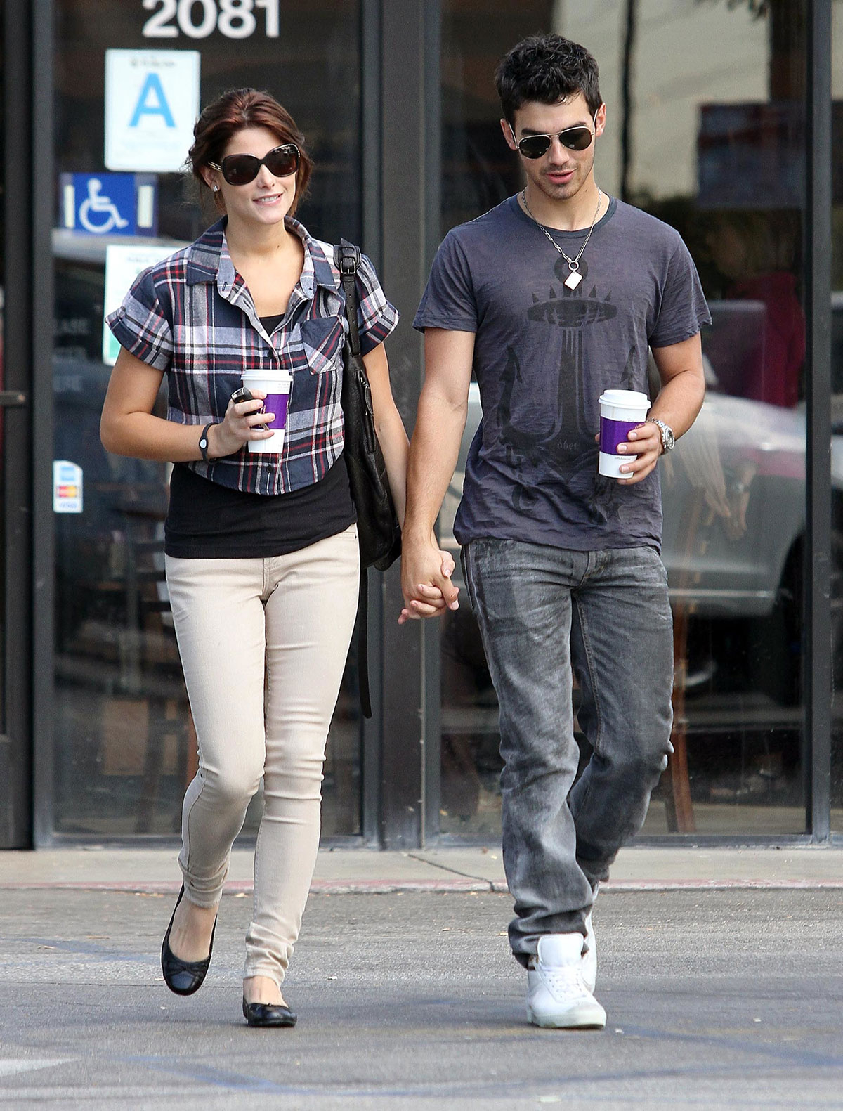 Sep 29 2010 ASHLEY GREENE and JOE JONAS can't keep their eyes or hands off each other, while getting their caffeine fix at a Coffee Bean in Los Feliz, CA