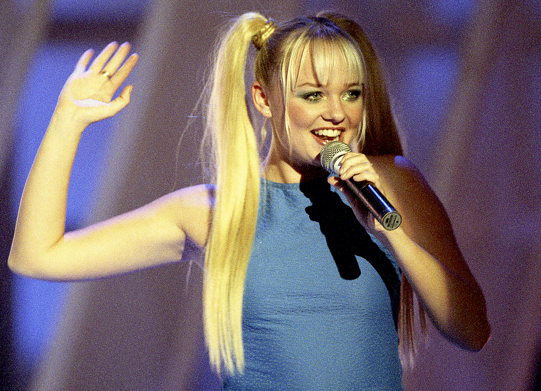 Emma Bunton performing live on stage in 1997.