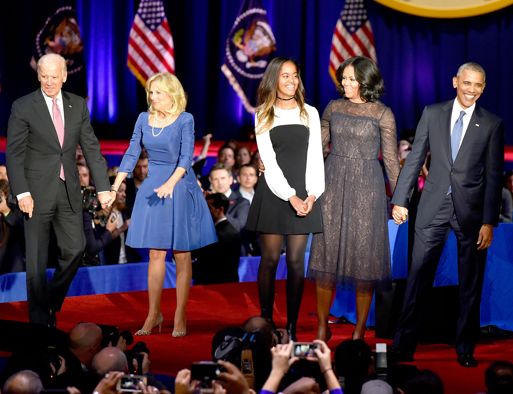 U.S. President Barack Obama is joined on stage by first lady Michelle Obama, their daughter Malia Obama, U.S. Vice President Joseph