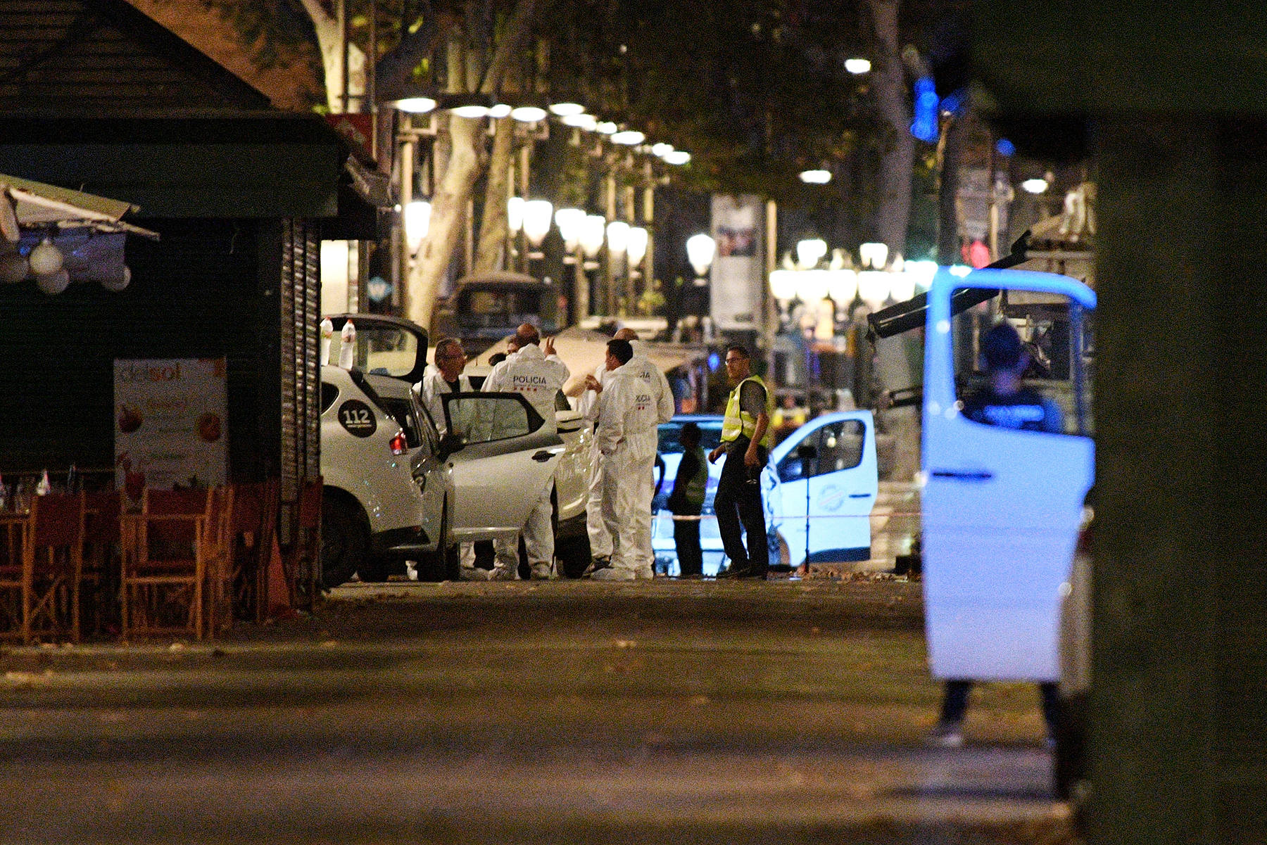 A damaged van, believed to be the one used in the attack, is surrounded by forensics officers in the Las Ramblas area on August 17, 2017 in Barcelona, Spain.
