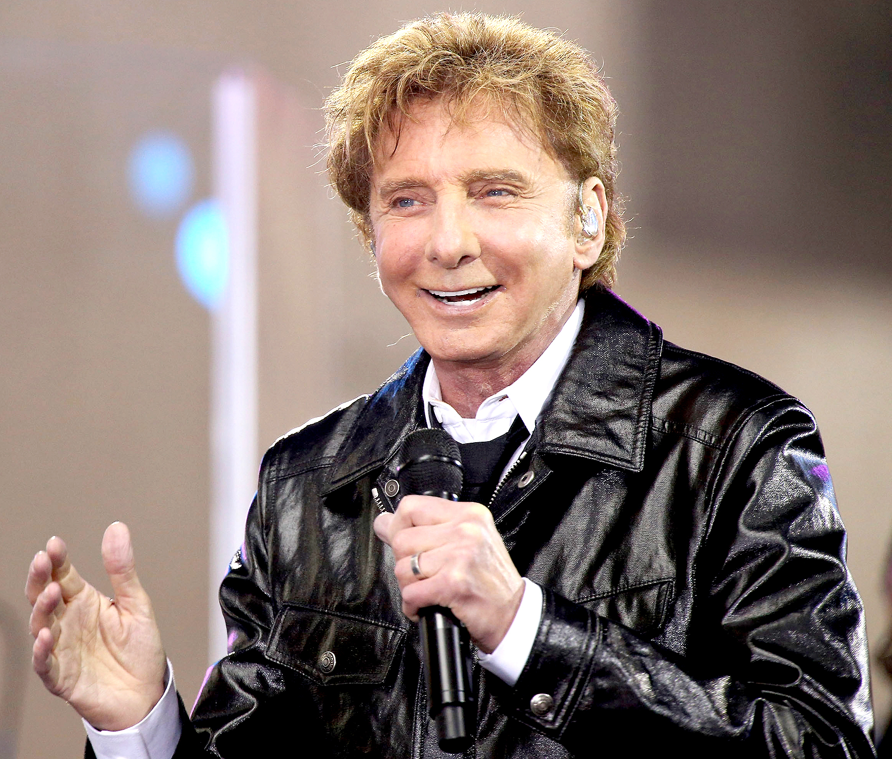 """Barry Manilow performs in the rain on NBC's """"Today"""" Show at Rockefeller Plaza on April 20, 2017 in New York City."""