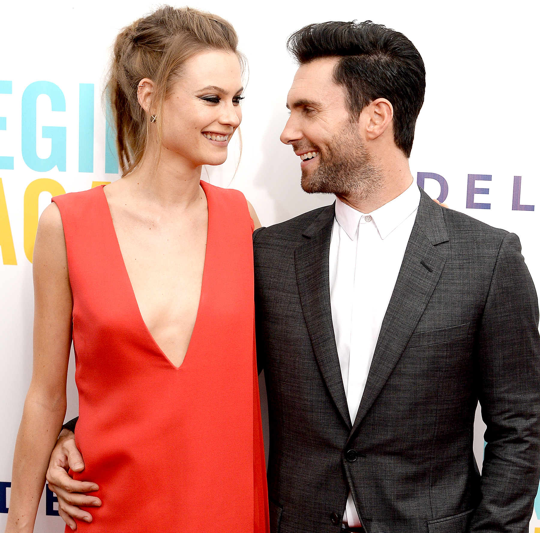 Behati Prinsloo and Adam Levine attend the