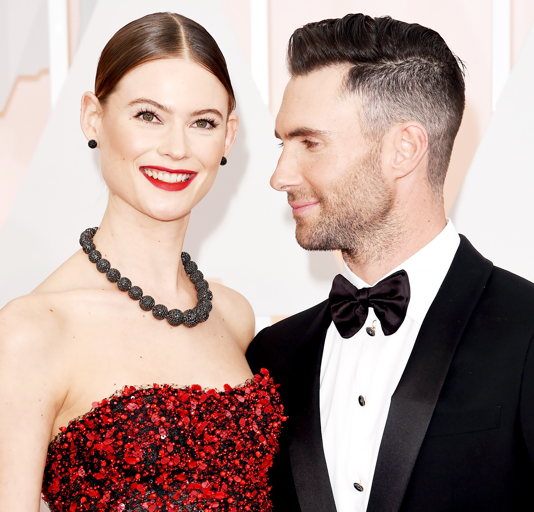 Adam Levine and Behati Prinsloo attend the 87th Annual Academy Awards.