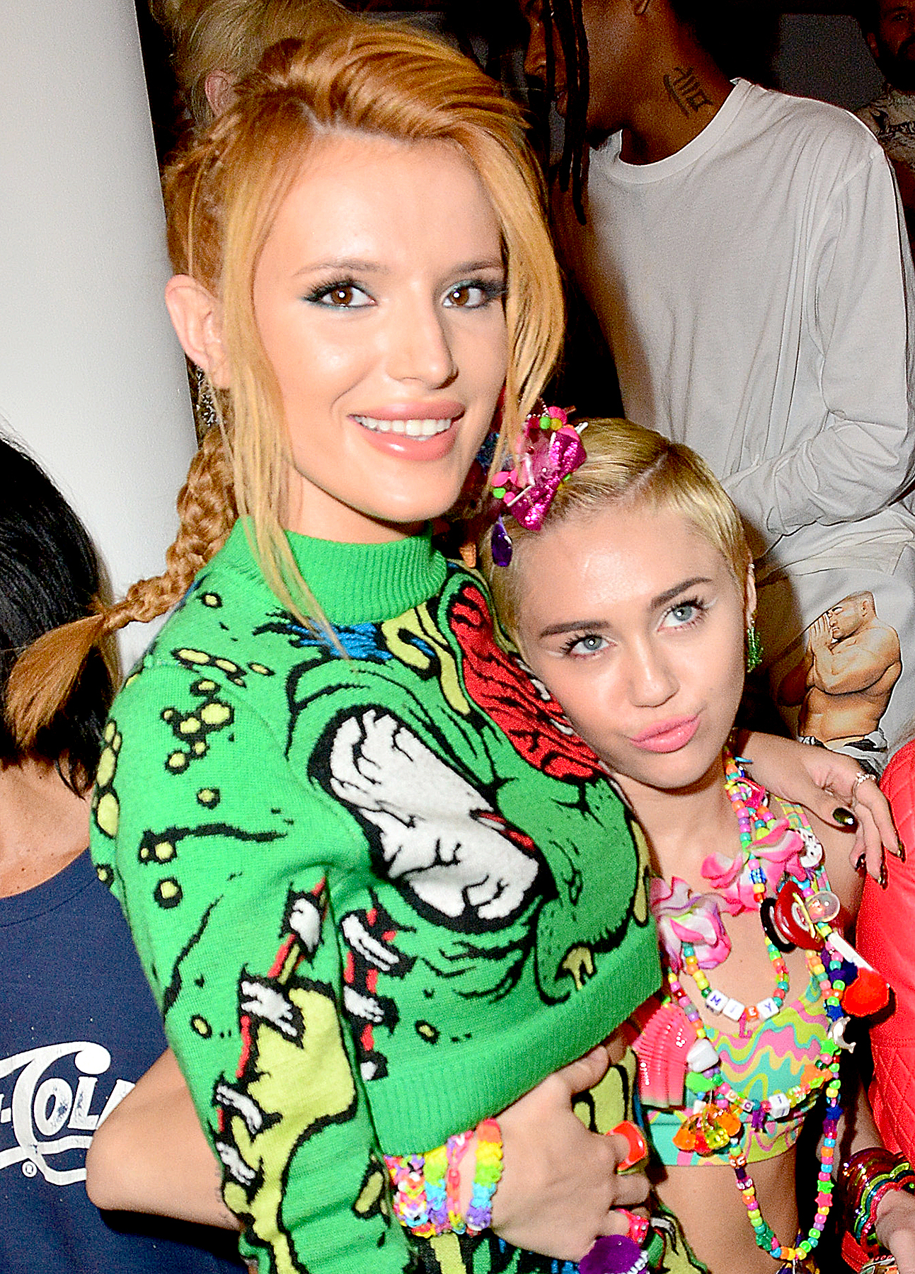 Bella Thorne and Miley Cyrus attend Jeremy Scott during MADE Fashion Week Spring 2015 at Milk Studios on September 10, 2014 in New York City.