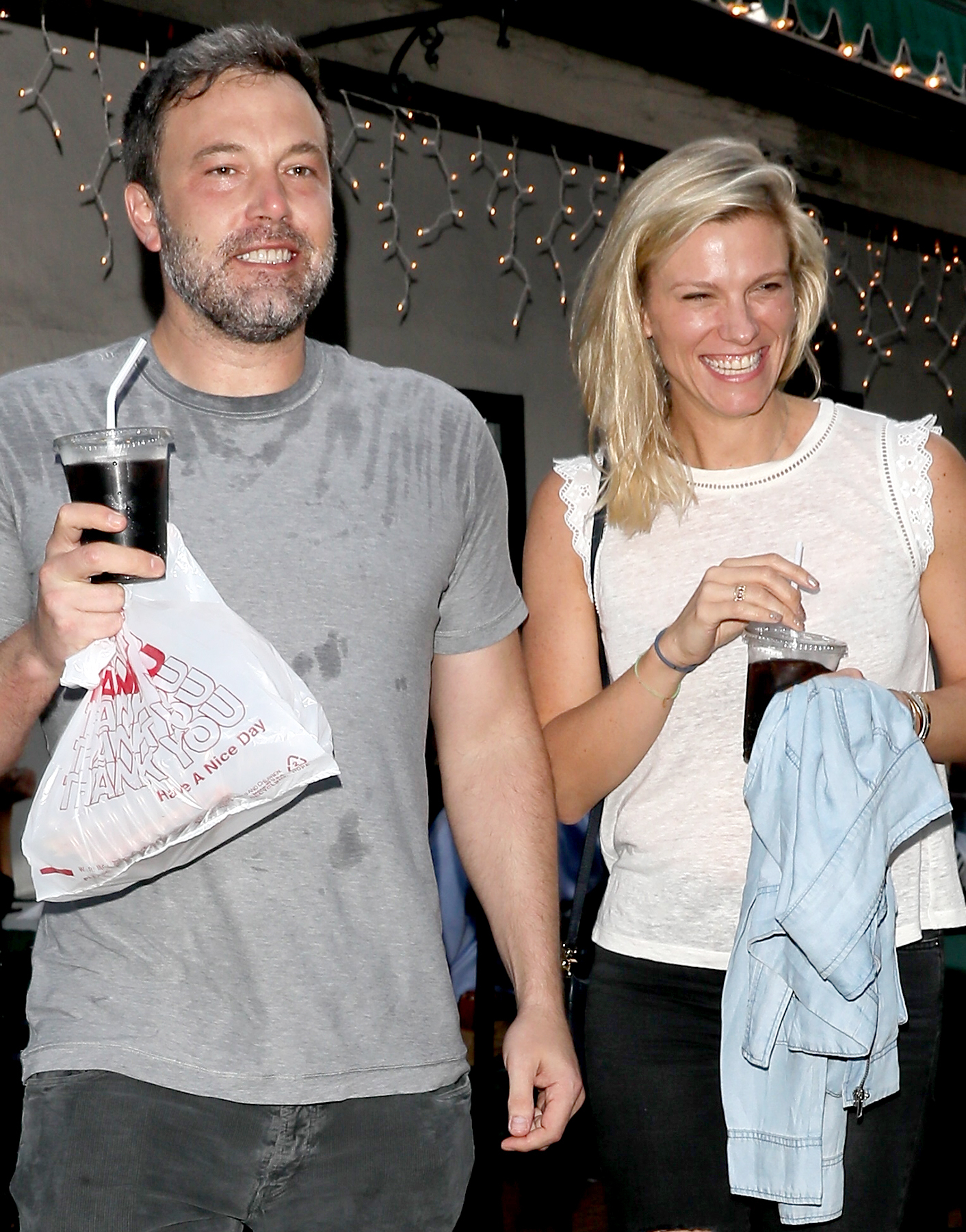 Ben Affleck looks extremely happy exiting Beech Street Cafe restaurant after having some pizza with new girlfriend Lindsay Shookus on July 10, 2017.