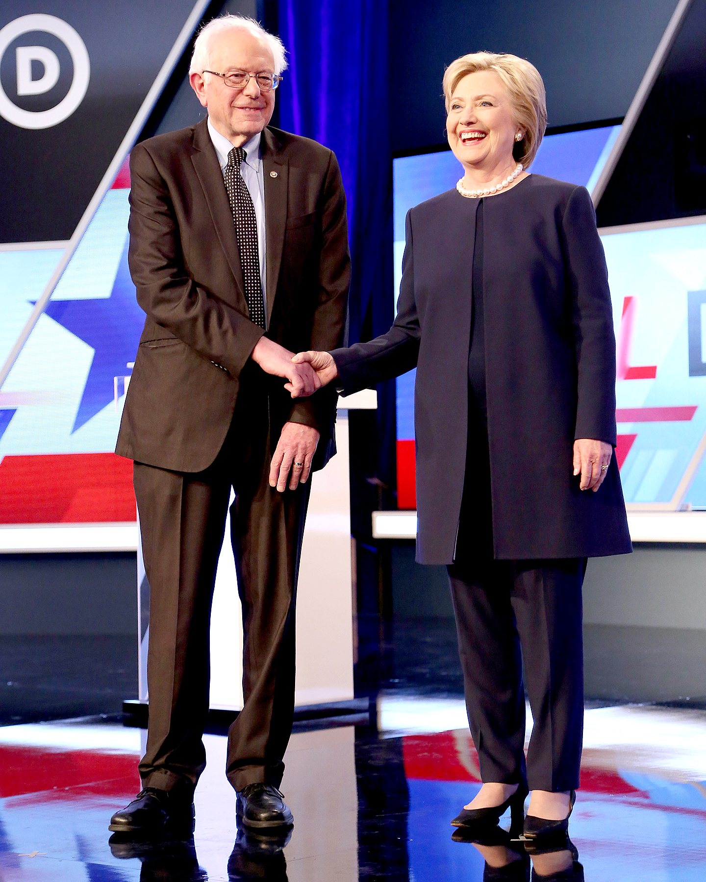 Bernie Sanders and Hillary Clinton are seen before the Univision News and Washington Post Democratic Presidential Primary Debate on the Miami Dade College Kendall Campus on March 9, 2016, in Miami.