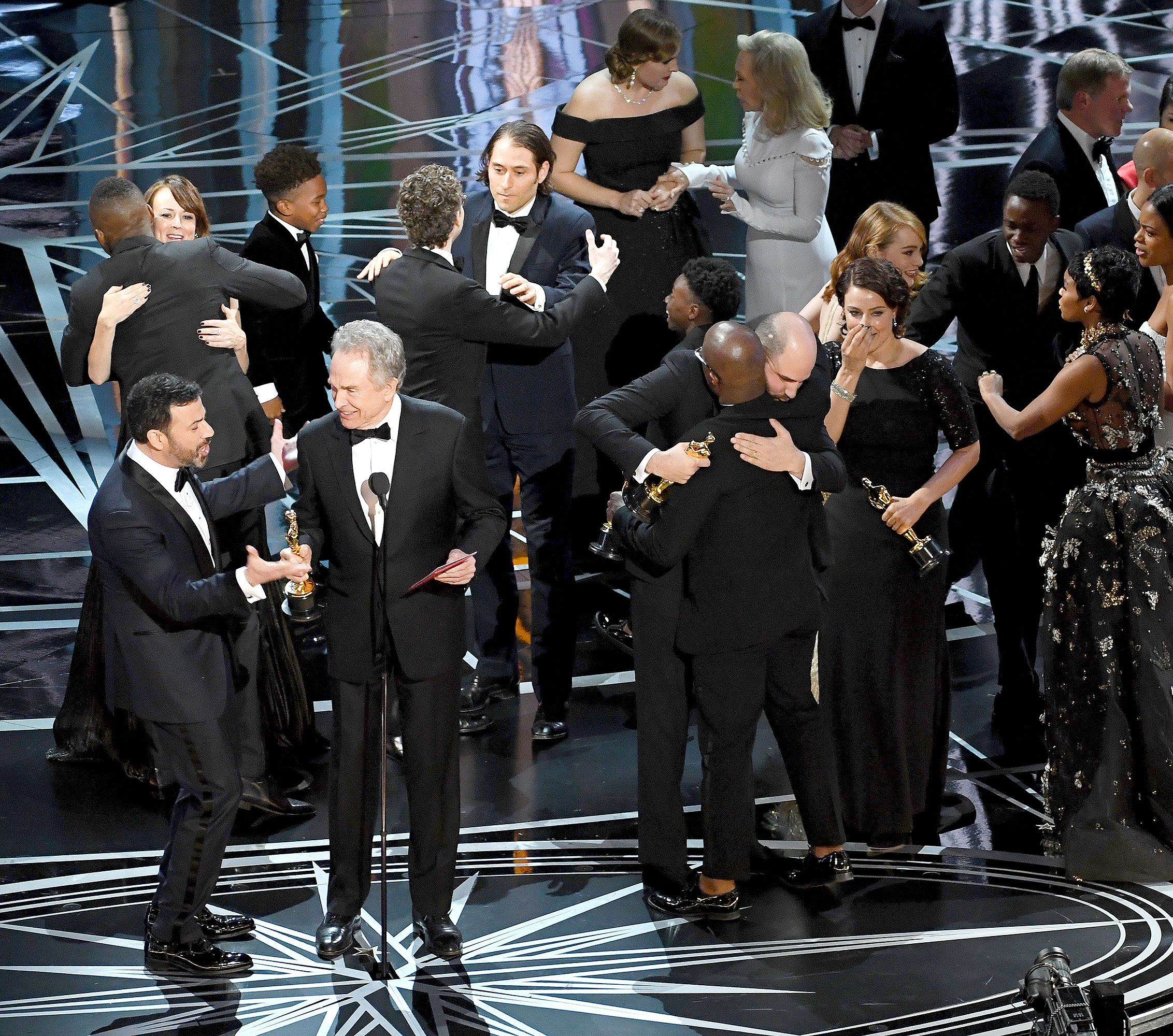 Actor Warren Beatty (C) explains a presentation error which resulted in Best Picture being announced as 'La La Land' instead of 'Moonlight' onstage during the 89th Annual Academy Awards at Hollywood & Highland Center on February 26, 2017