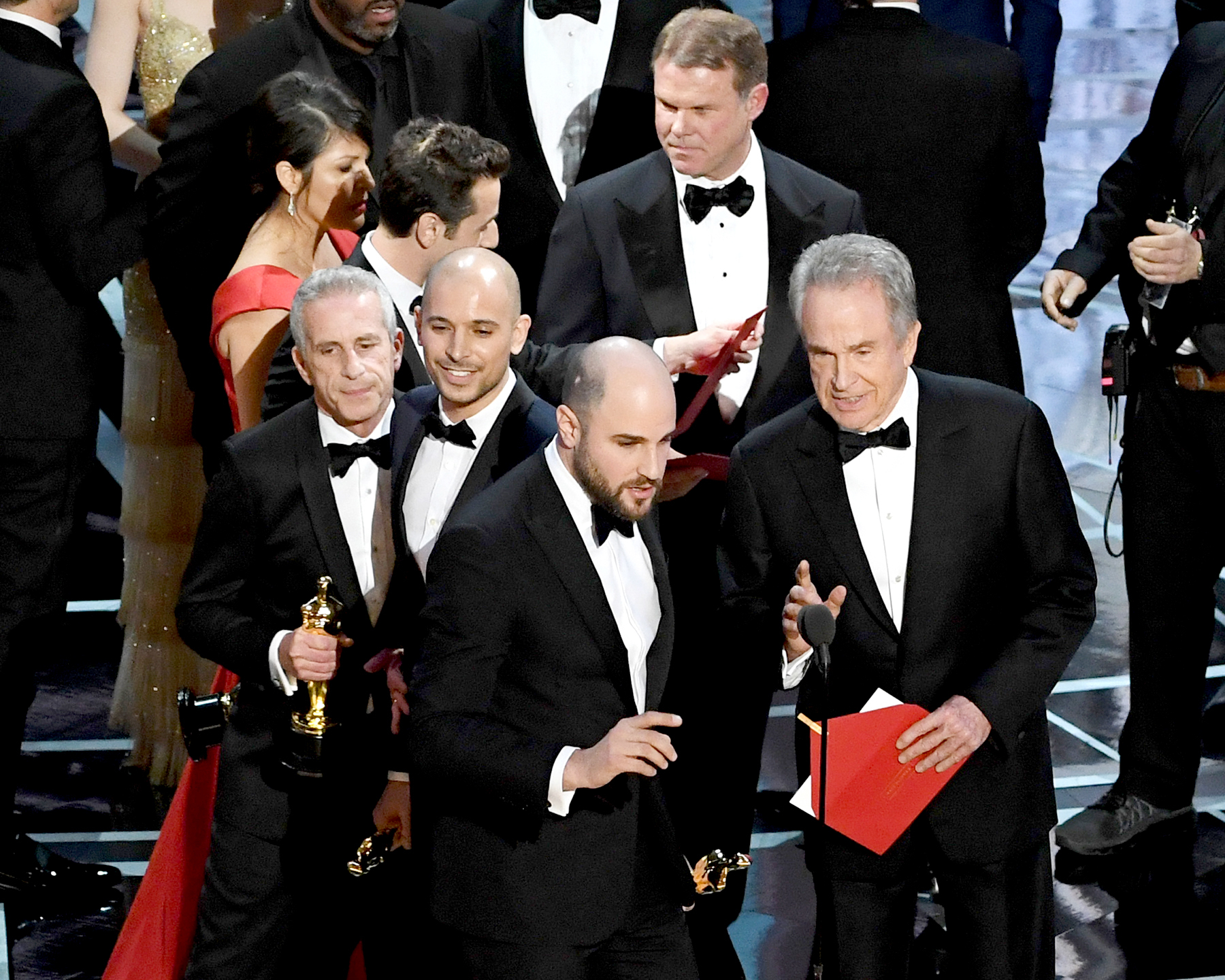 'La La Land' producer Jordan Horowitz (L) announces actual Best Picture winner as 'Moonlight' after a presentation error with actor Warren Beatty onstage during the 89th Annual Academy Awards at Hollywood & Highland Center on February 26, 2017 in Hollywood, California.