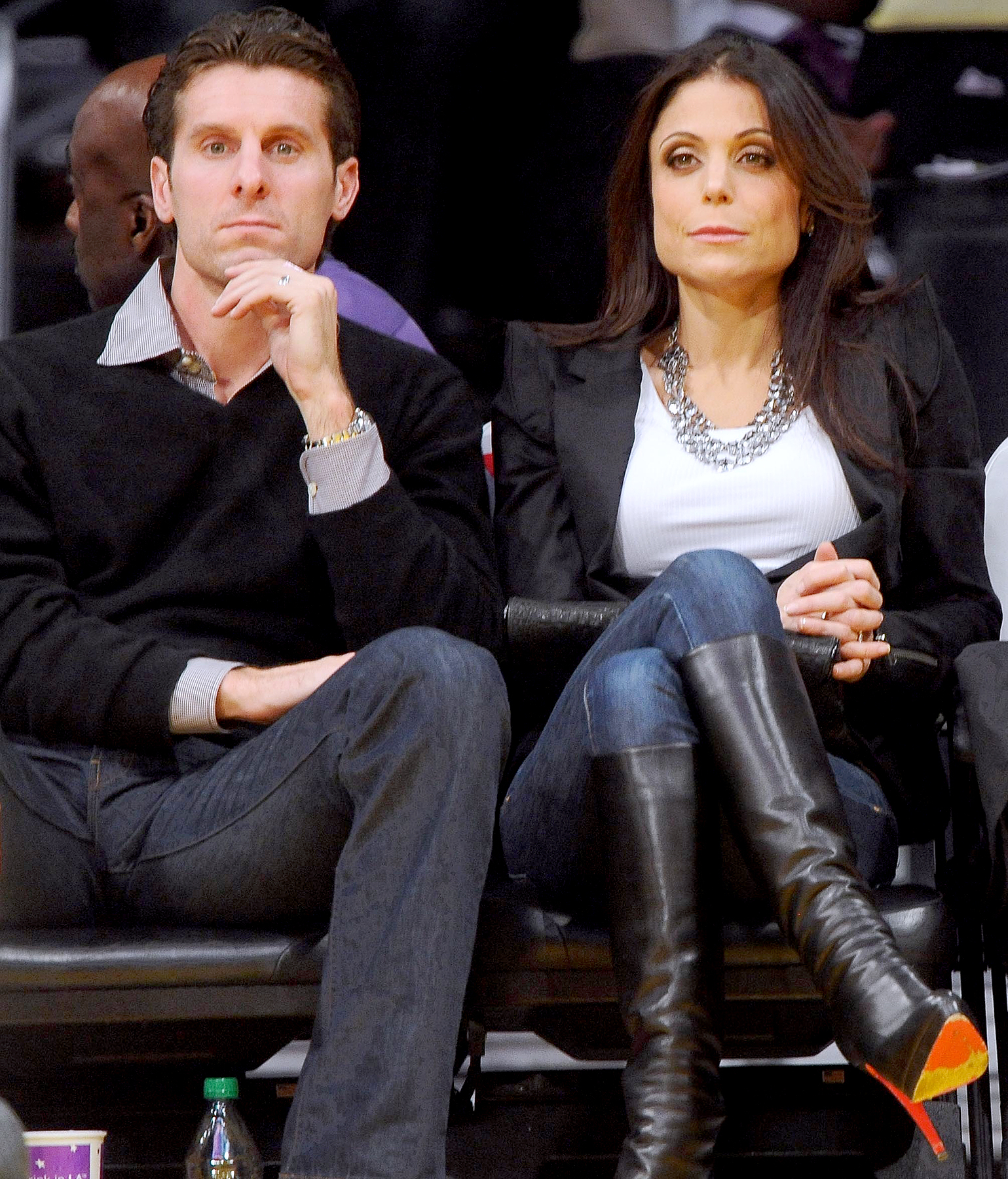 Bethenny Frankel and Jason Hoppy sit courtside as they attend the Los Angeles Lakers/Sacramento Kings NBA game at Staples Center in Los Angeles on December 3, 2010.