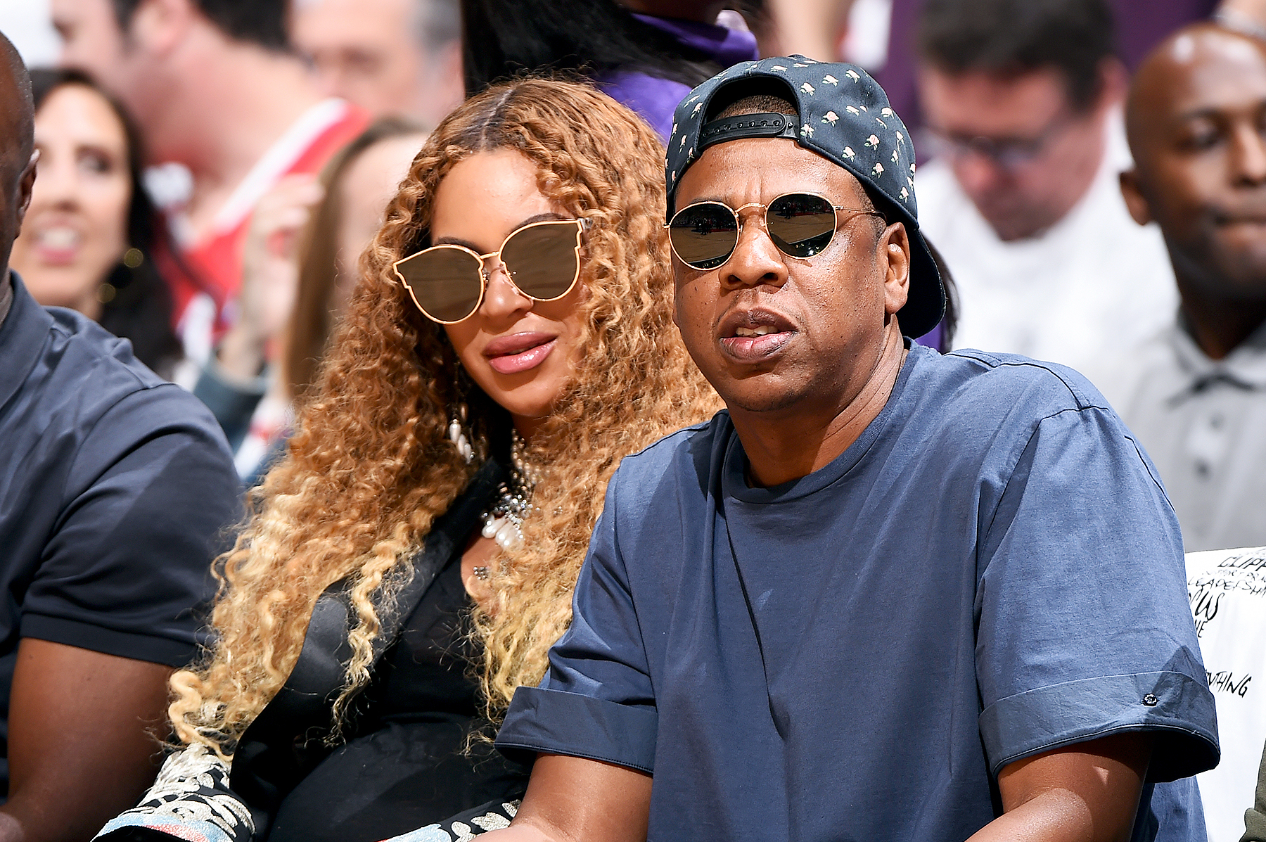 Jay Z Cradles Beyonce's Baby Bump at Basketball Game