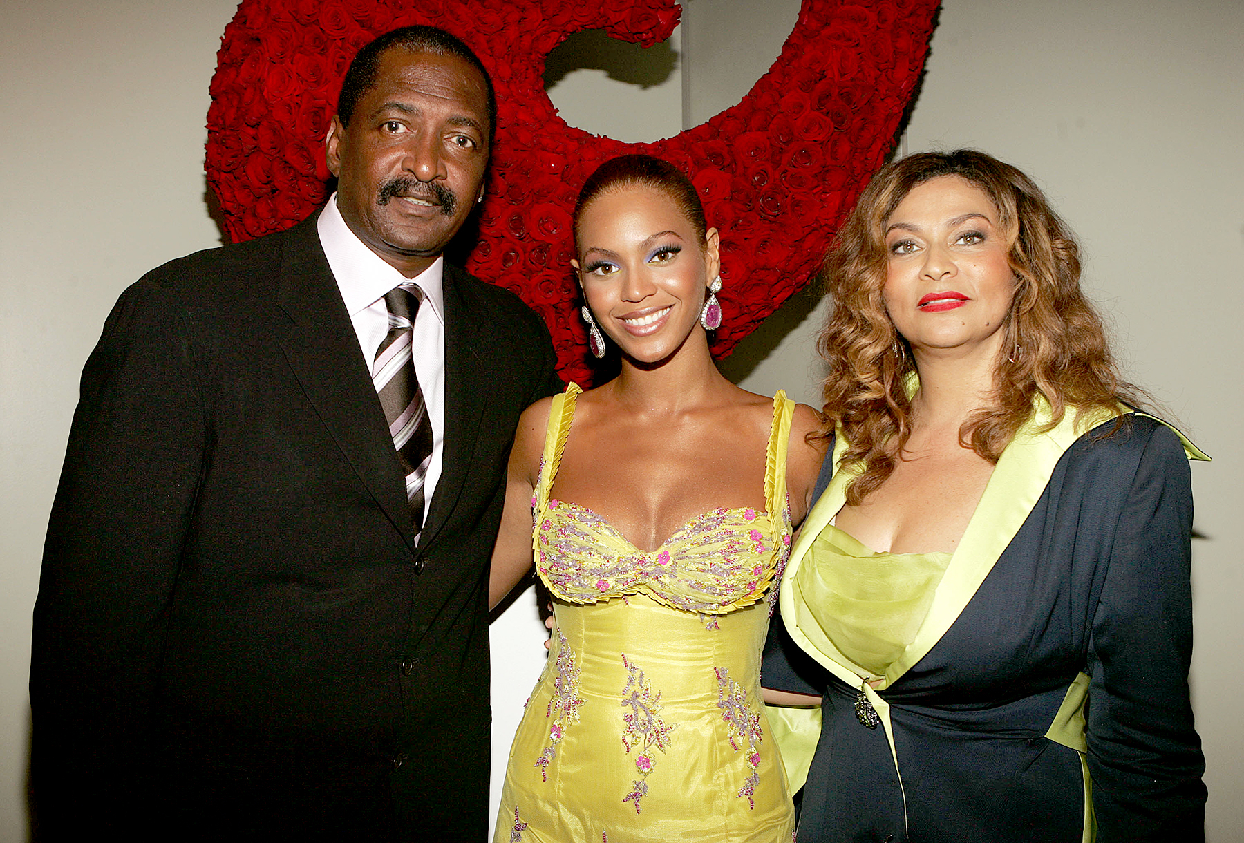 Beyonce Knowles poses with her father, Matthew Knowles, and her mother, Tina Knowles, June 2005 in NYC.