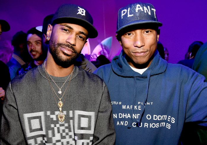Rapper Big Sean and singer-songwriter Pharrell Williams attend adidas Originals Pink Beach Pharrell Williams party on May 13, 2016 in West Hollywood, California.