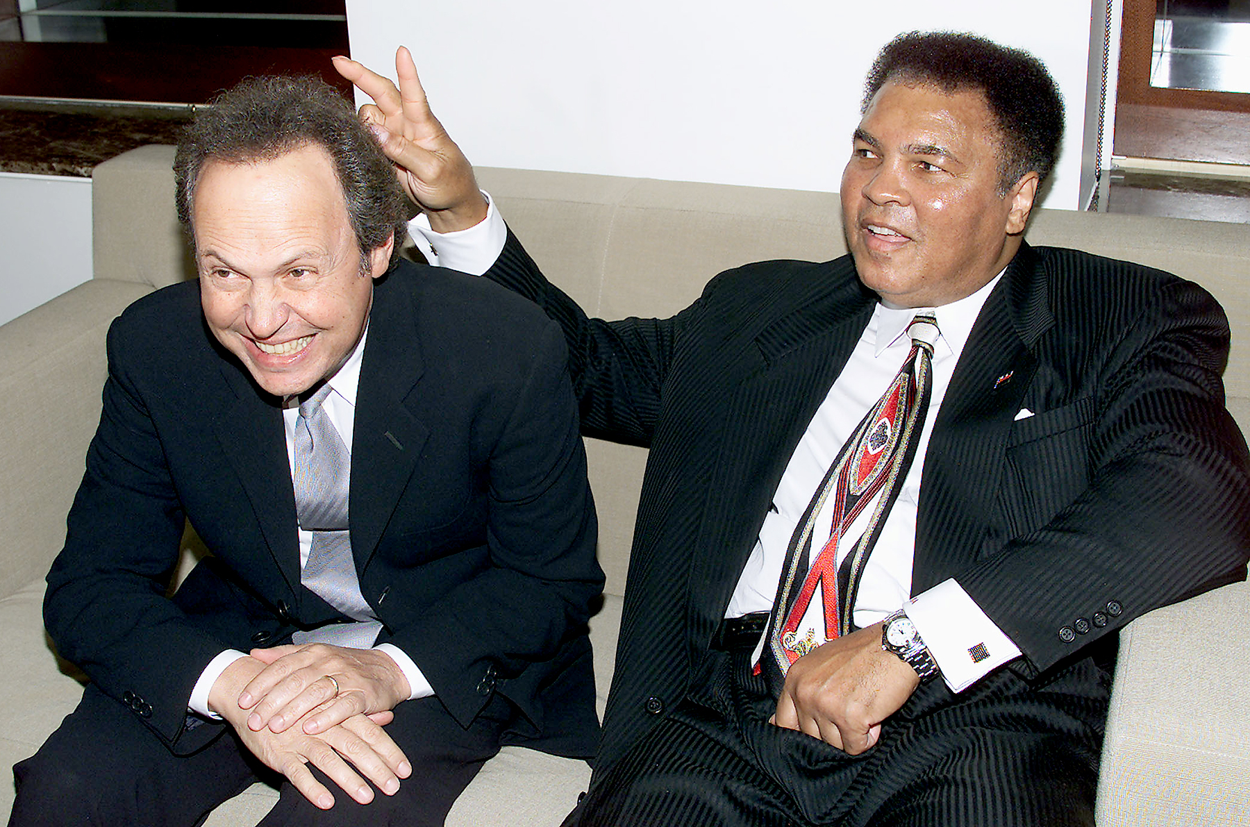 Billy Crystal and Muhammad Ali at Audemars Piguet's Time to Give Celebrity Watch Auction for Charity, held at Christie's in NYC in 2000.