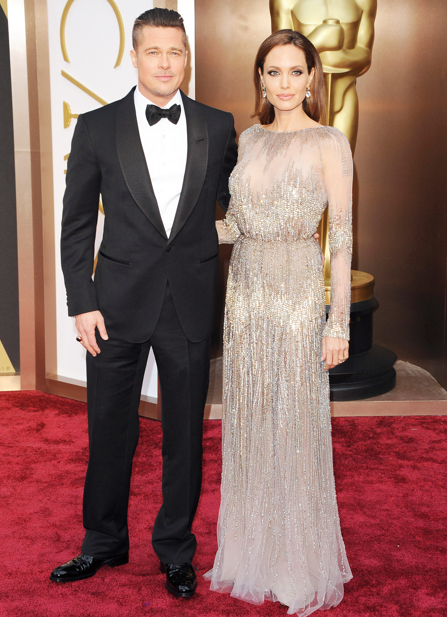 Brad Pitt and Angelina Jolie arrive at the 86th Annual Academy Awards at Hollywood & Highland Center on March 2, 2014 in Hollywood, California.