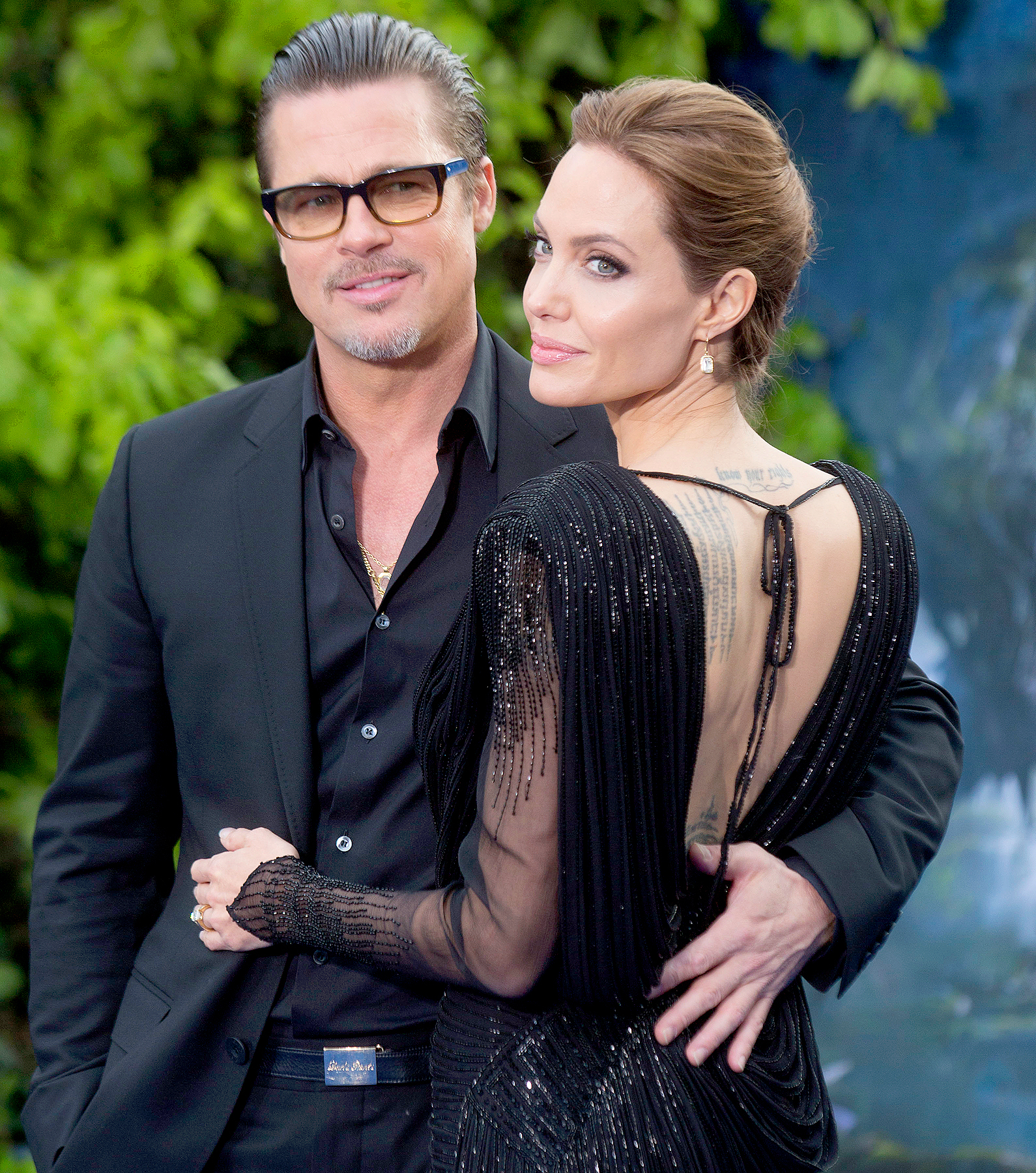 Brad Pitt and Angelina Jolie attend a private reception as costumes and props from Disney's