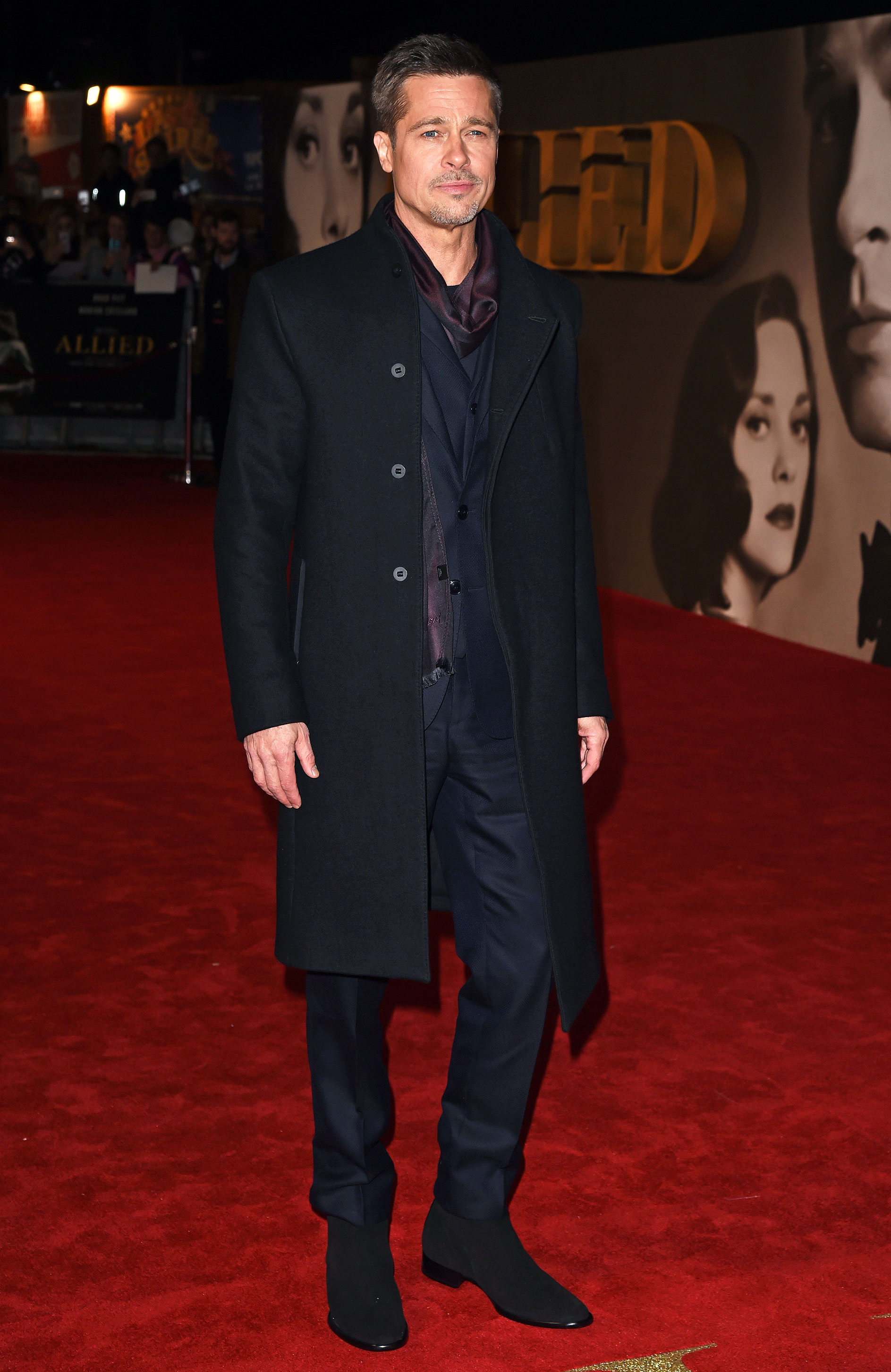brad pitt - Just a day after Allied 's red carpet premier in Paris, Pitt took a similar approach in his look by opting for another dark-colored suit, scarf and coat for the London premiere.