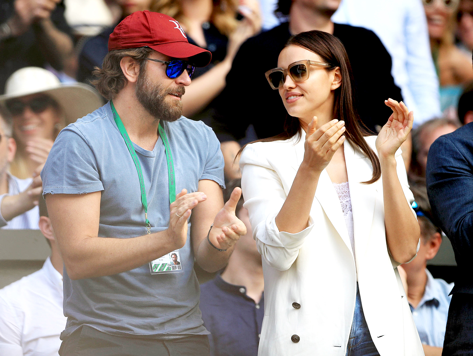 Bradley Cooper and Irina Shayk watch the action on centre court between Roger Federer and Marin Cilic on day nine of the Wimbledon Championships at the All England Lawn Tennis and Croquet Club, Wimbledon in July 2016.