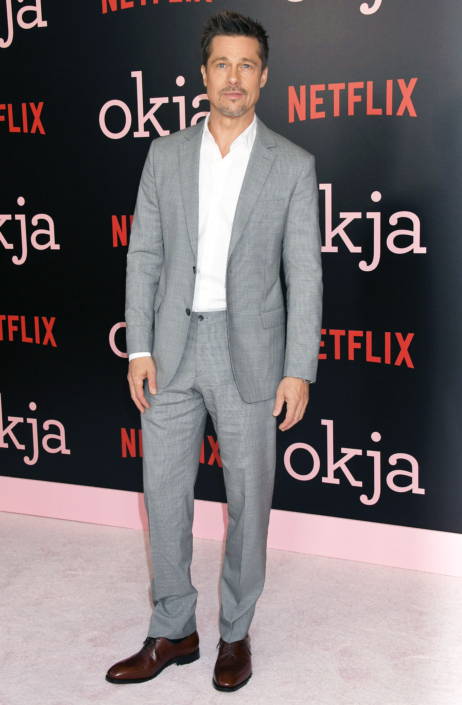 Brad pitt - In a gray suit with a crisp white button-down and brown shoes at the Okja premiere in NYC on June 8, 2017.