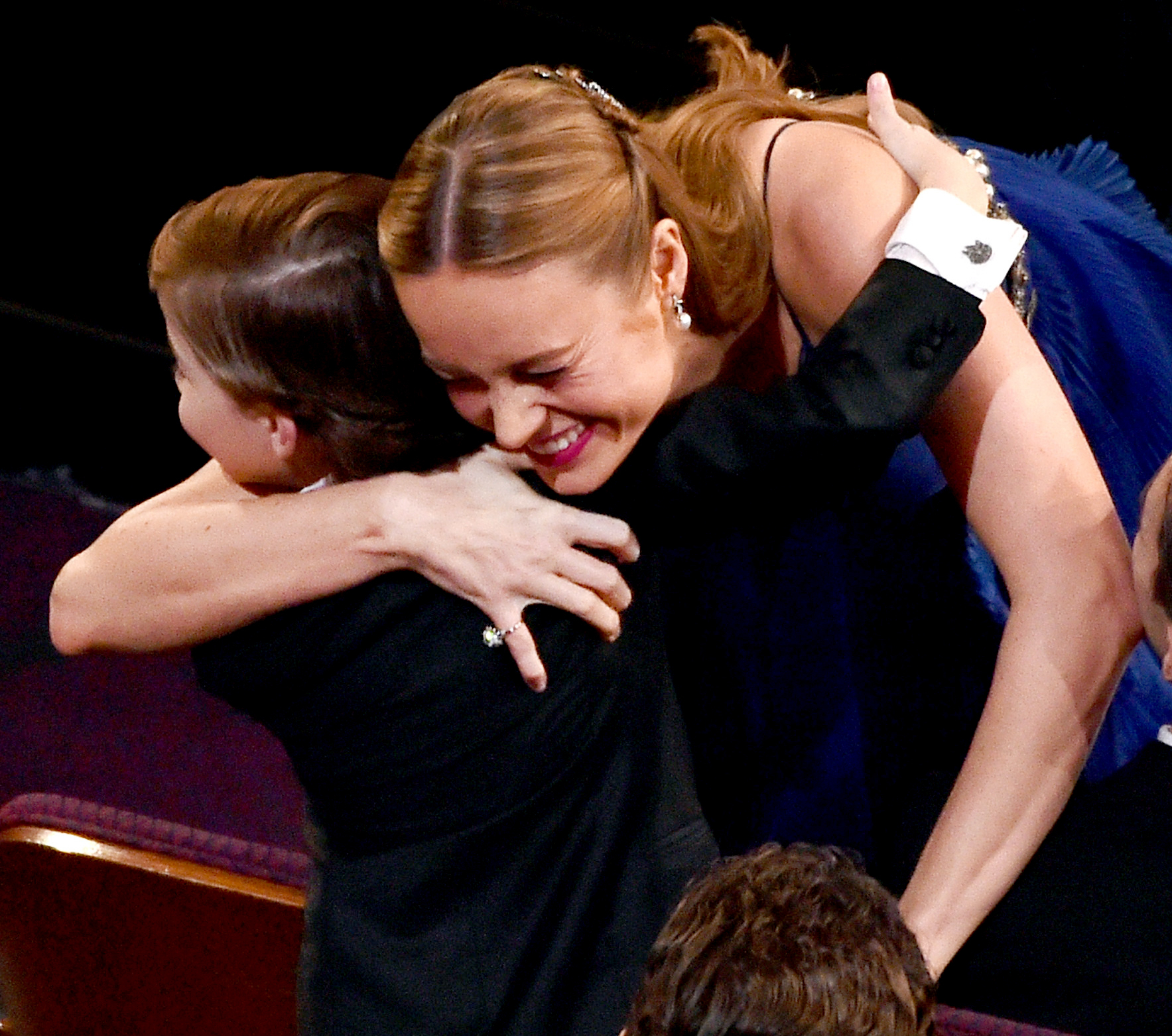 Brie Larson embraces actor Jacob Tremblay after winning the Best Actress award for 'Room' during the 88th Annual Academy Awards.