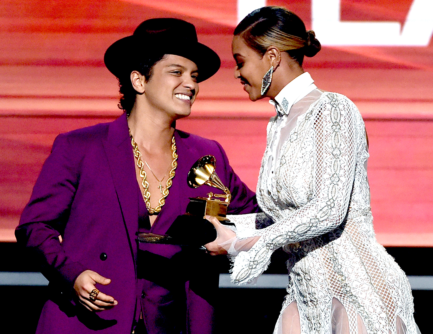 Beyonce (R) presents the Record Of The Year award to recording artist Bruno Mars for 'Uptown Funk' onstage during The 58th GRAMMY Awards at Staples Center on February 15, 2016 in Los Angeles, California.