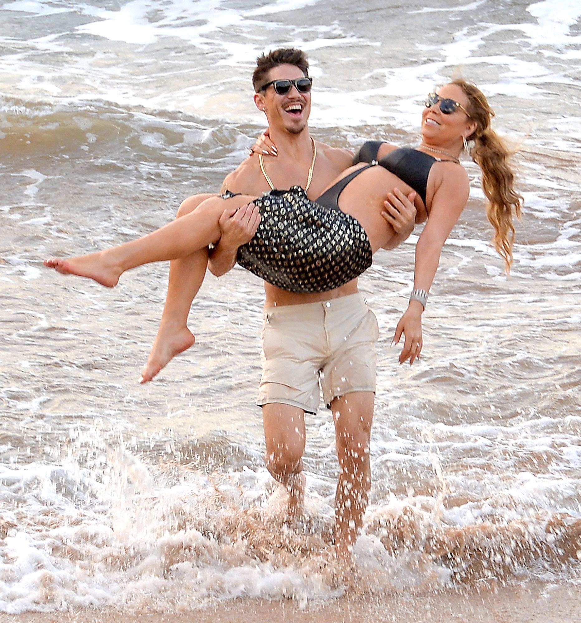 FameFlynet AKM GSI. Mariah Carey Kisses Bryan Tanaka in Hawaii   Photos
