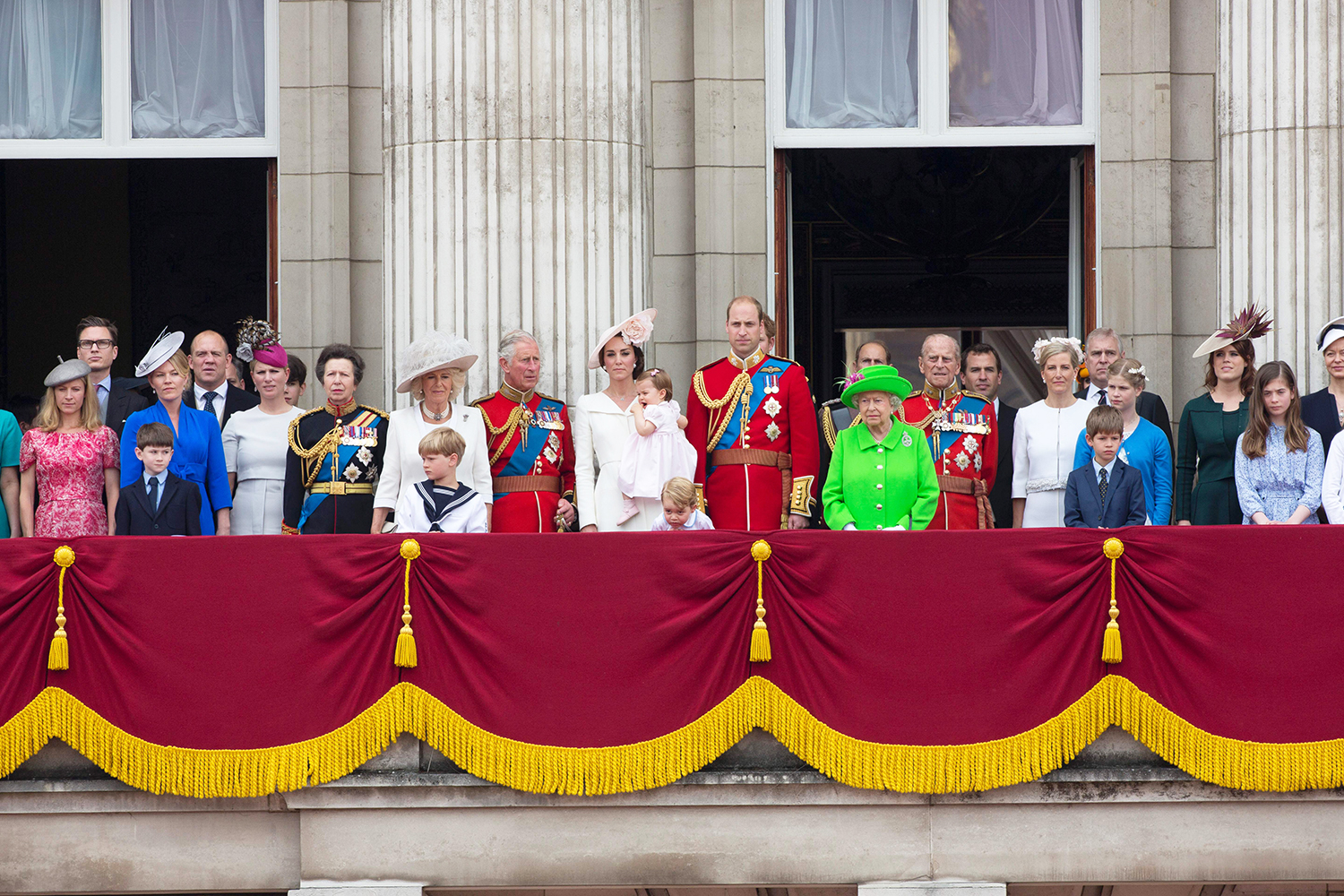 Members of the Royal family and guests stand on the balcony of Buckingham Palace to watch a fly-past of aircrafts by the Royal Air Force, in London on June 11, 2016.