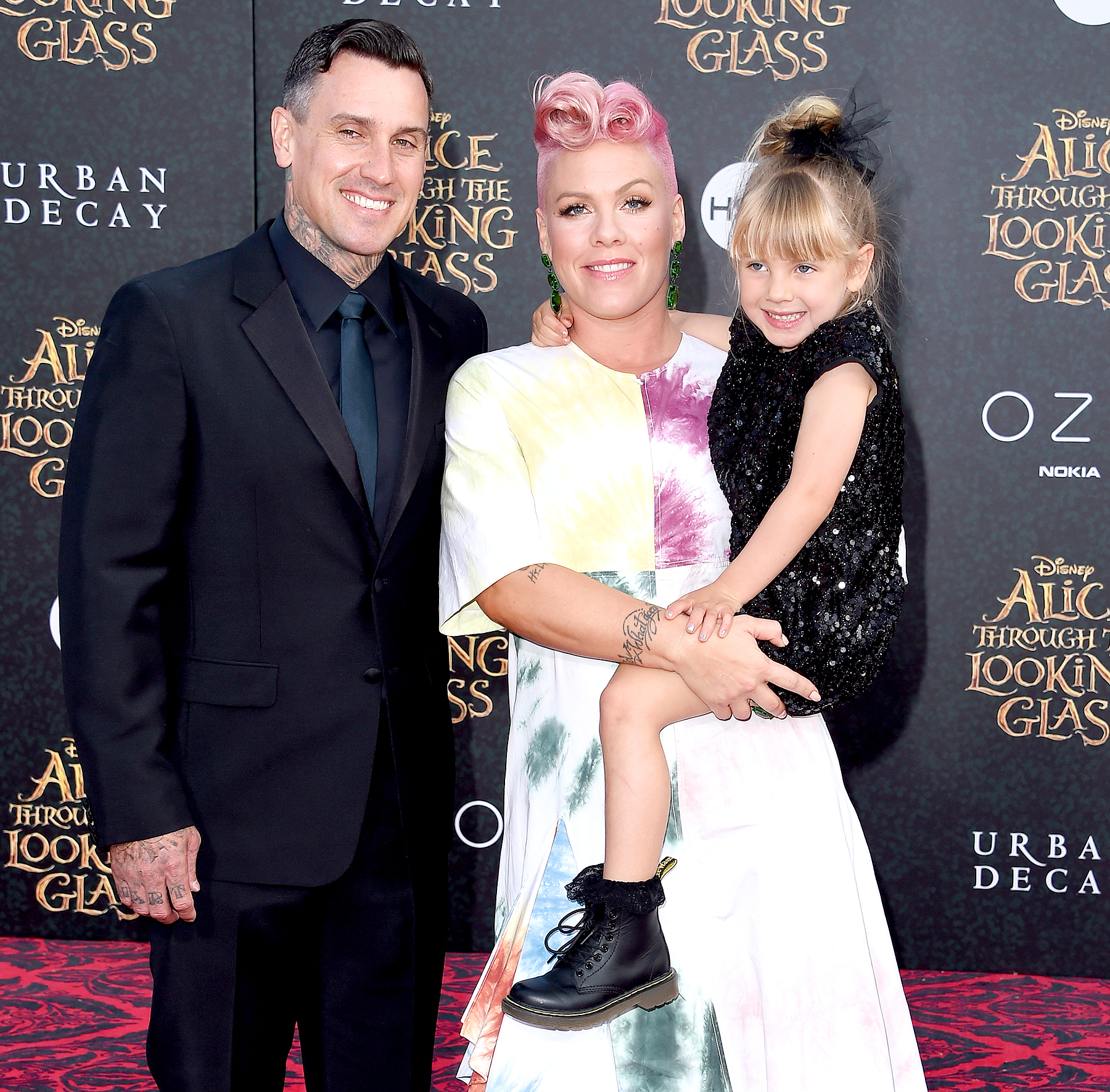 Carey Hart, Pink and Willow Sage Hart arrive at the premiere of Disney's 'Alice Through The Looking Glass' at the El Capitan Theatre on May 23, 2016 in Hollywood, California.